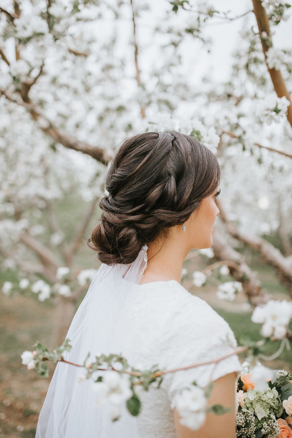 bridal-hairstyle-updo-wedding-trends-2020-effortless-braided-updo-look-for-the-light-photo-video