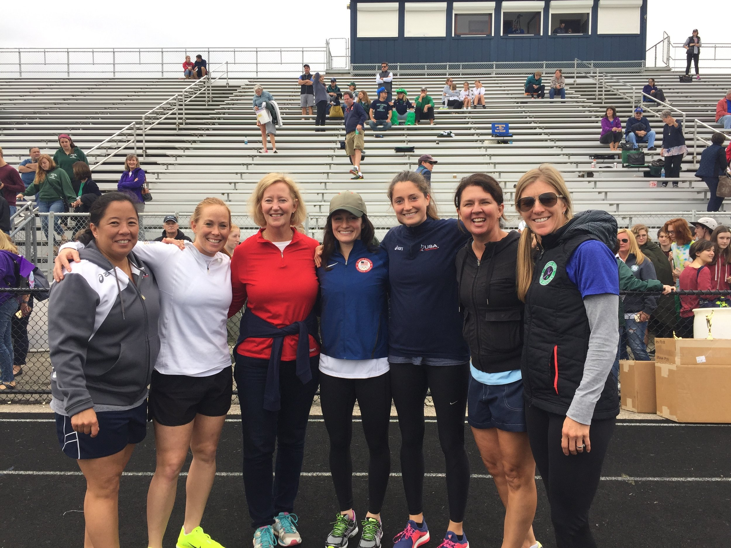 Olympians Liz Tchou, Lauren Crandall, Michelle Vittese and Katie Beach present trophies at the state championships.