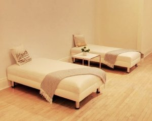 two+white+leather+ottomans.jpg