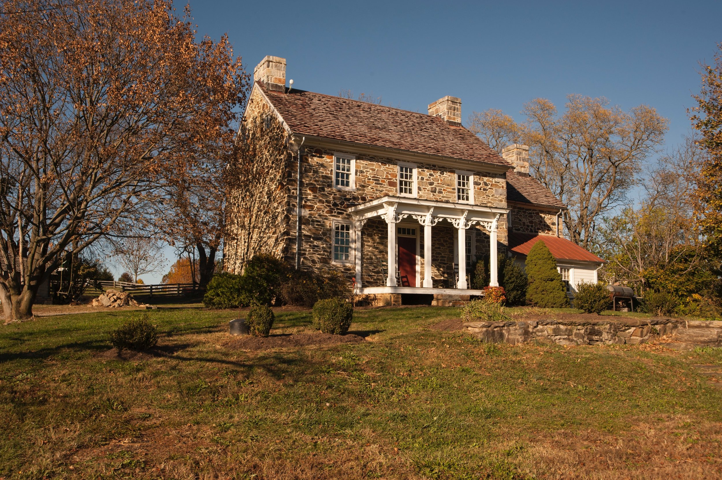 The main stone house from the drive.
