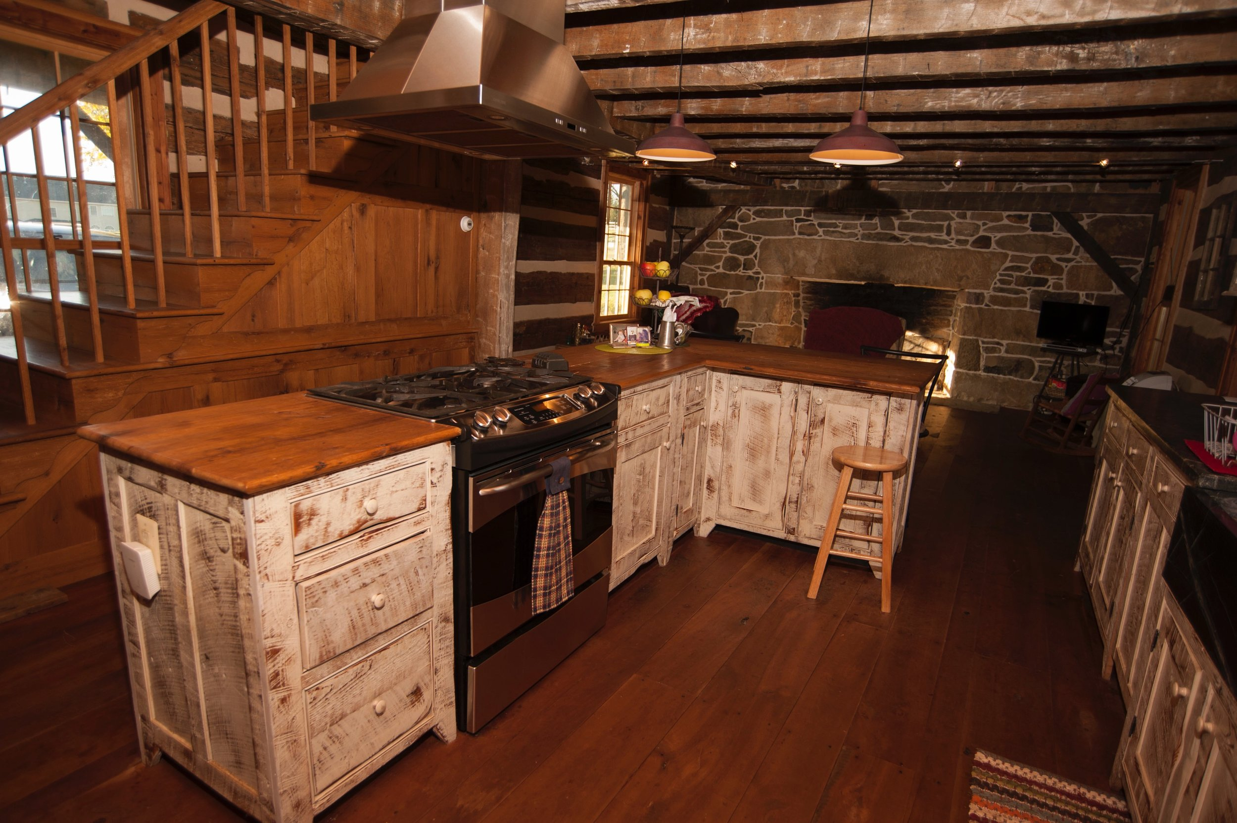 The log house kitchen features cabinetry designed and built by Allen Cochran.