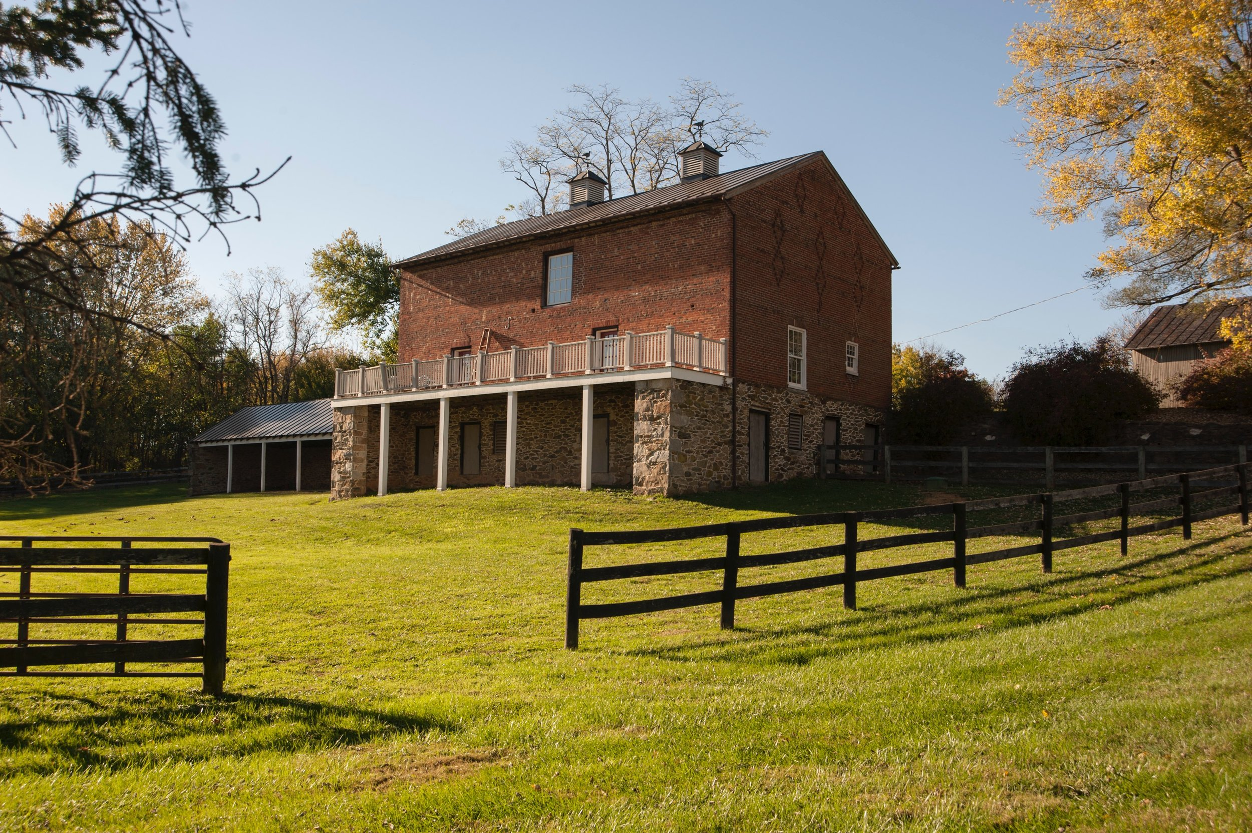 The three-level side of the brick bank barn.