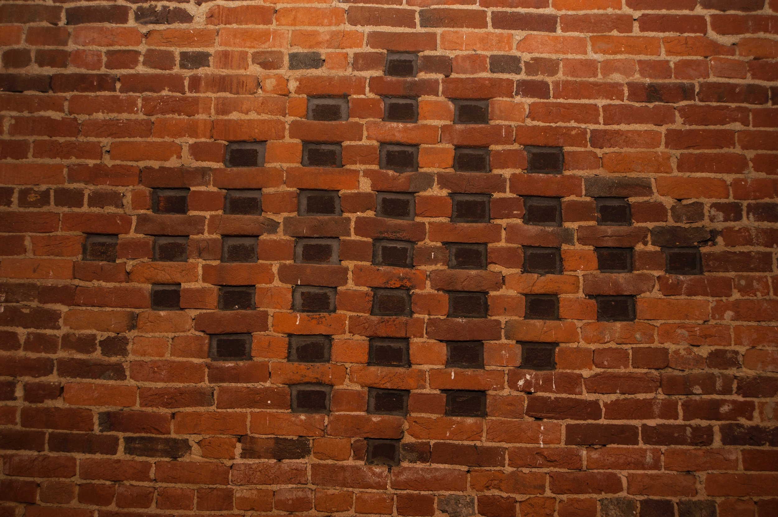 """""""Vents"""" were engineered by Allen Cochran to resemble the real thing. To give the illusion of openings, he set black bricks on end and recessed them."""
