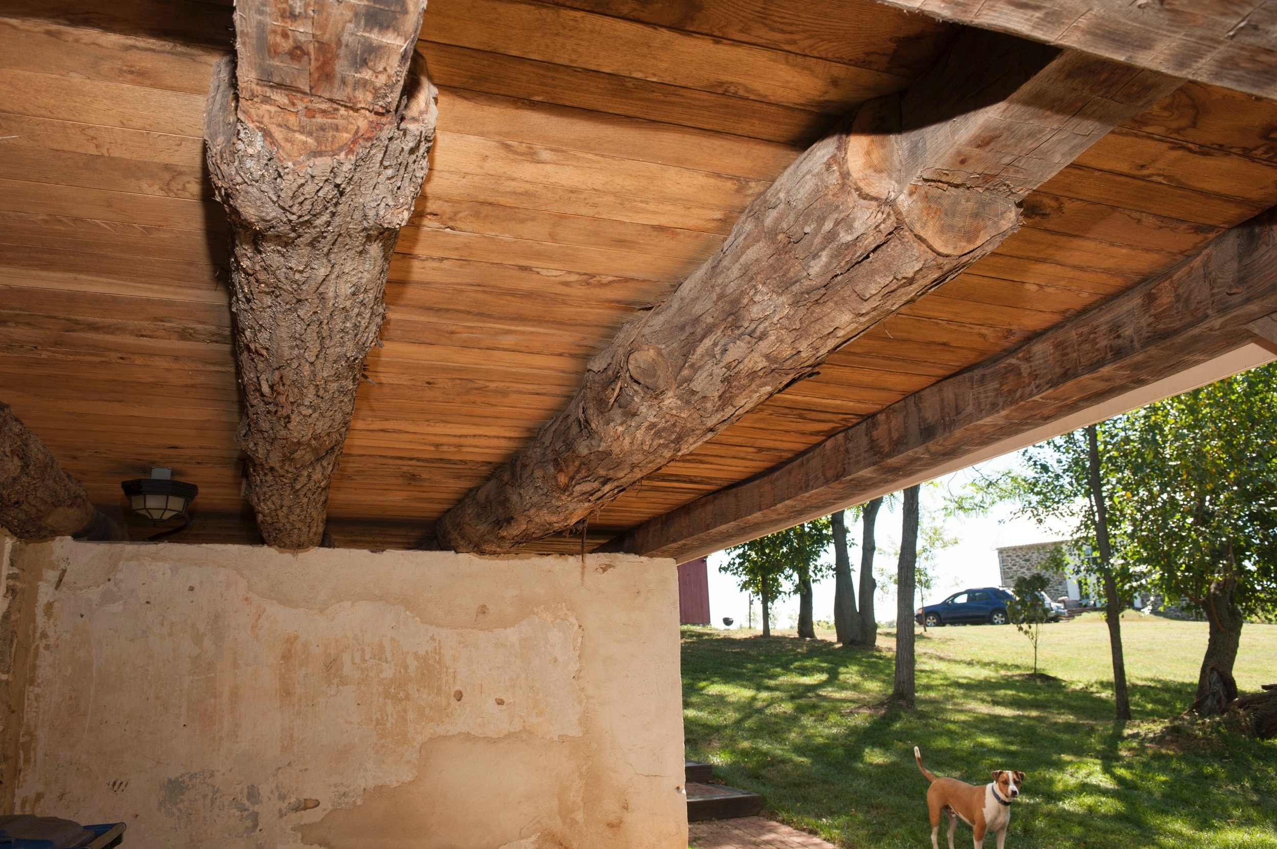 Hand hewn beams support porch.