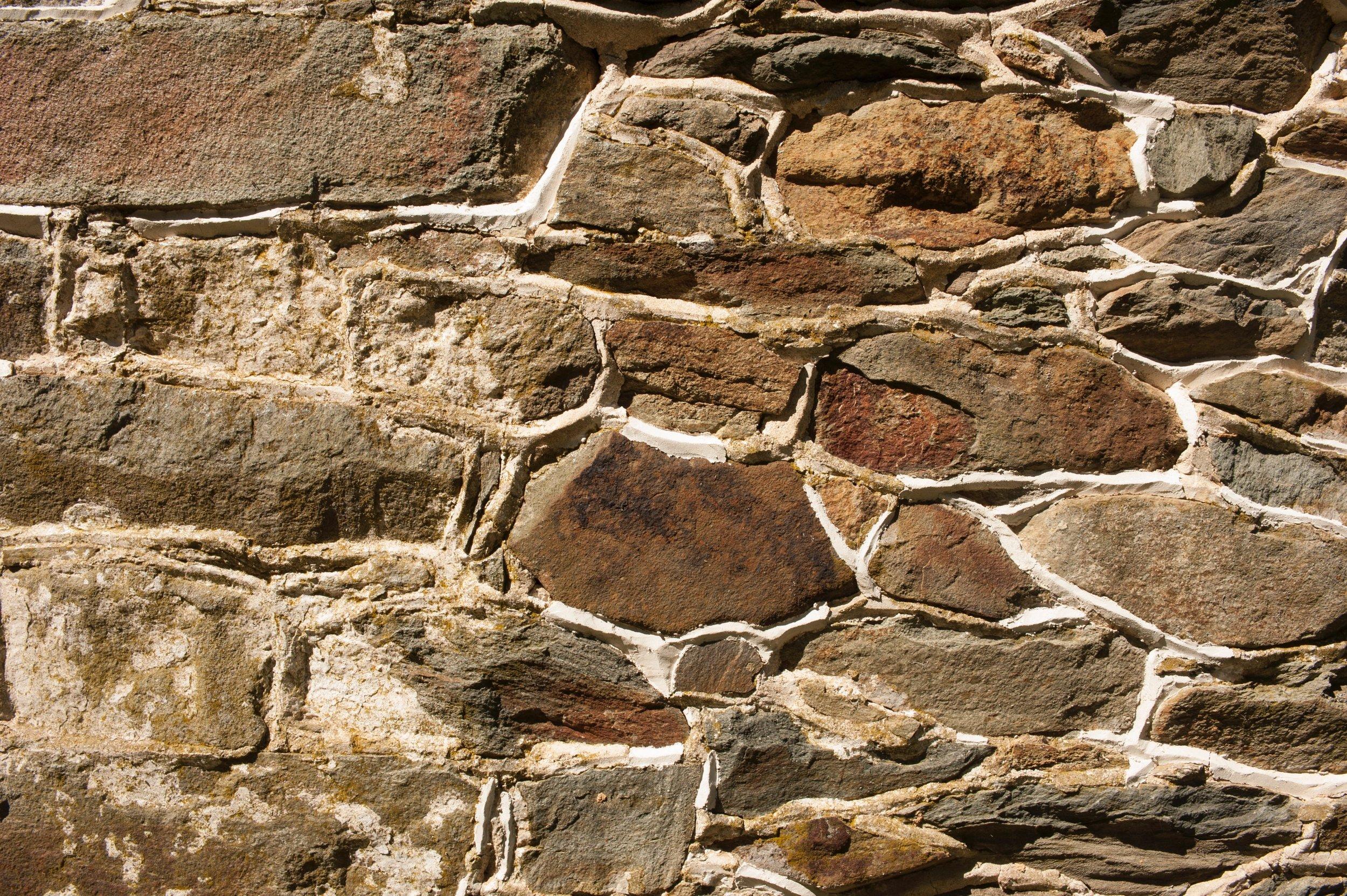New masonry matches original farmhouse stonework.