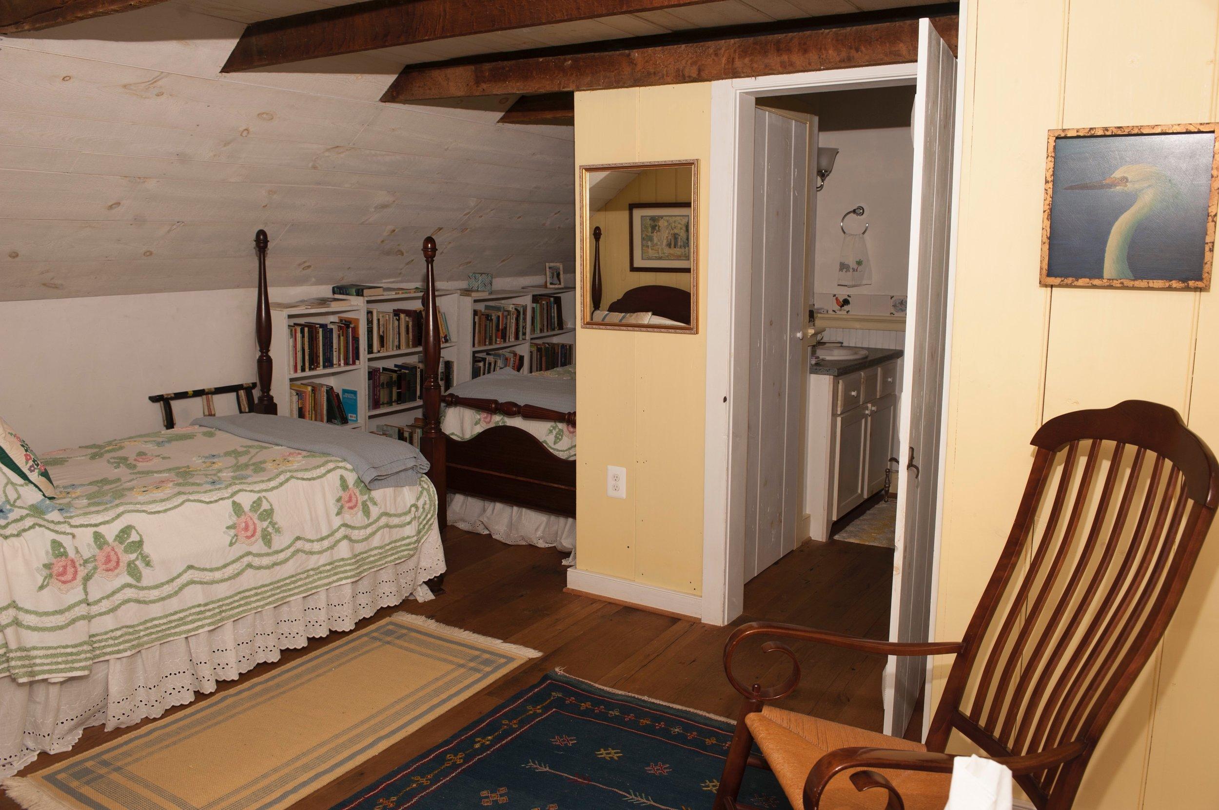 Upstairs bedroom with adjacent bath..