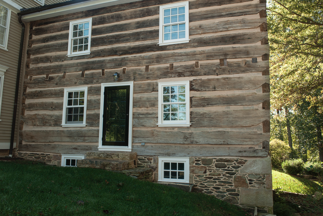 Three-level front facade of log building.
