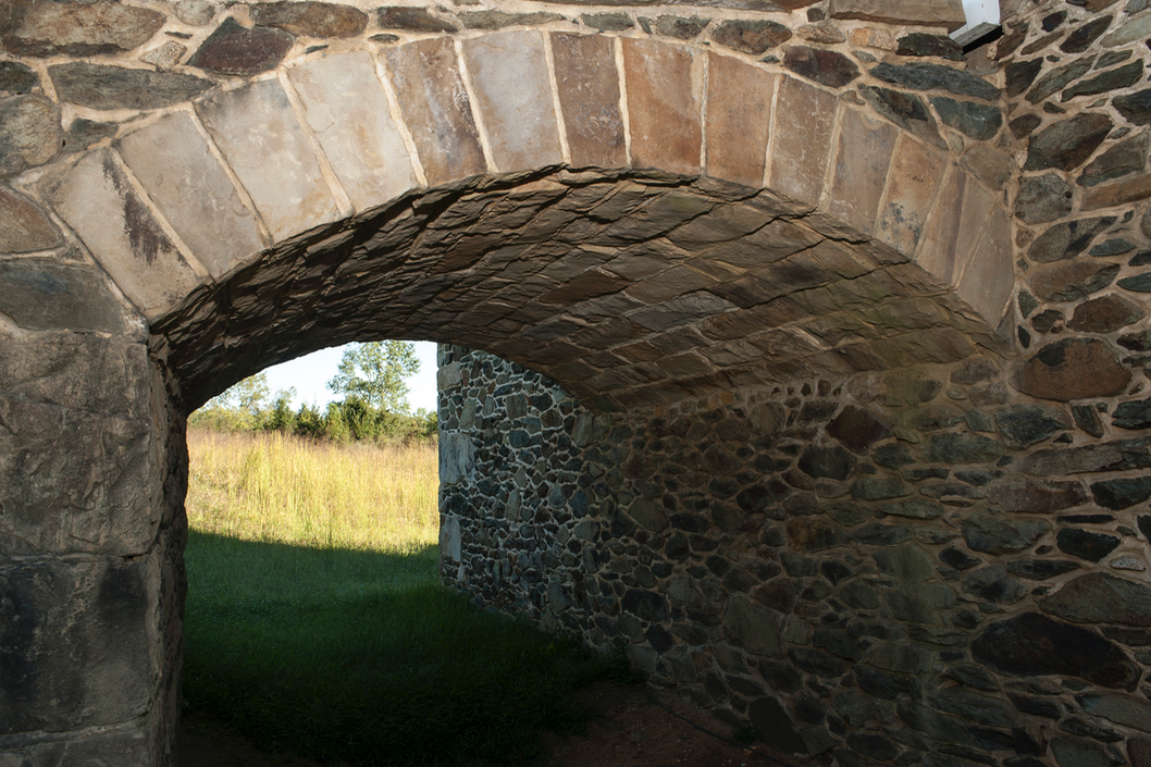 The stone arch supports the barn ramp.