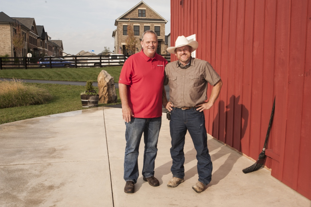 Mike Bailey, the developer's point man on the barn reconstruction, with Allen Cochran.
