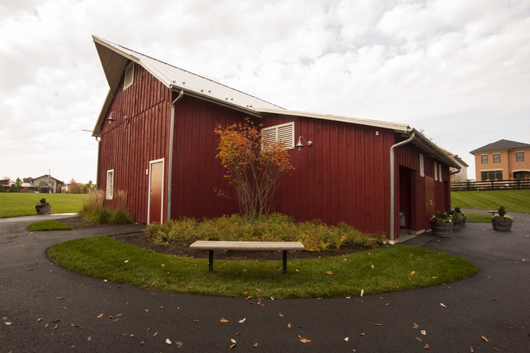 The peak enhances the barn's design.
