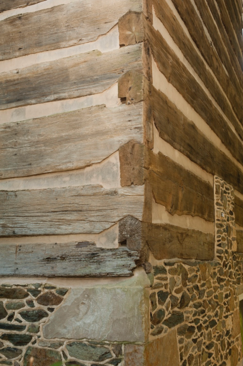 Corner with notched logs.