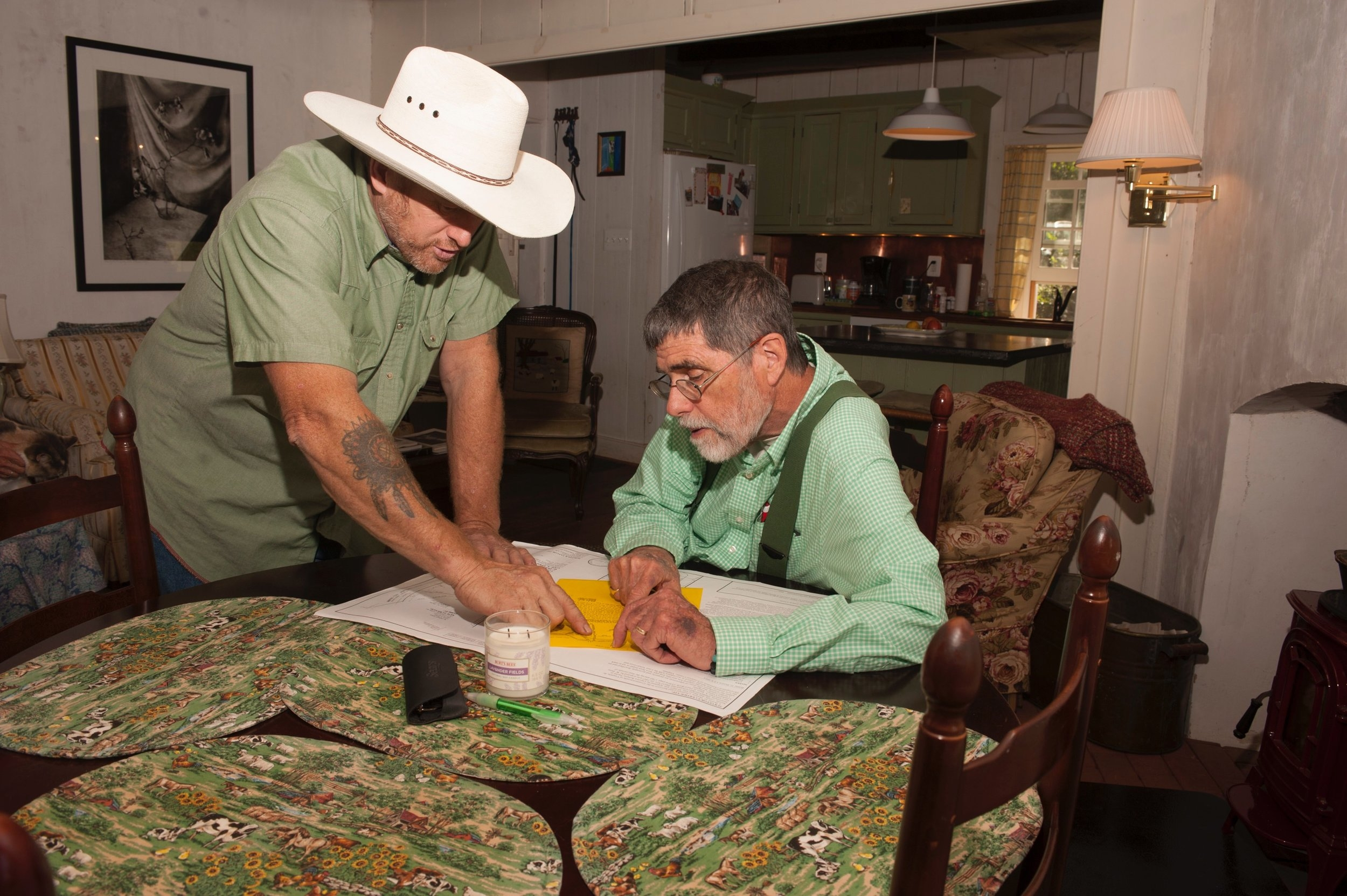 Allen Cochran reviews the property plat with Perry Epes as they make plans for a fence.