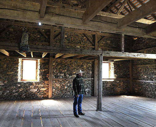 """Allen Cochran in a barn outside Middleburg that his company built for Alan Croft over three years. The barn is a replica of a shed that once sat near the Dulles Greenway and the Route 7 Bypass. """"As far as I'm concerned,"""" he said, the barn is """"our crown jewel."""""""
