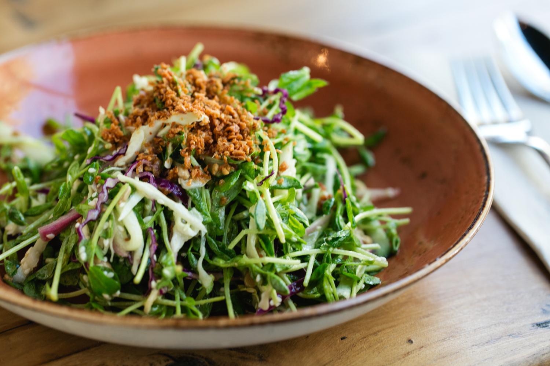 Teni East Kitchen pea shoot salad
