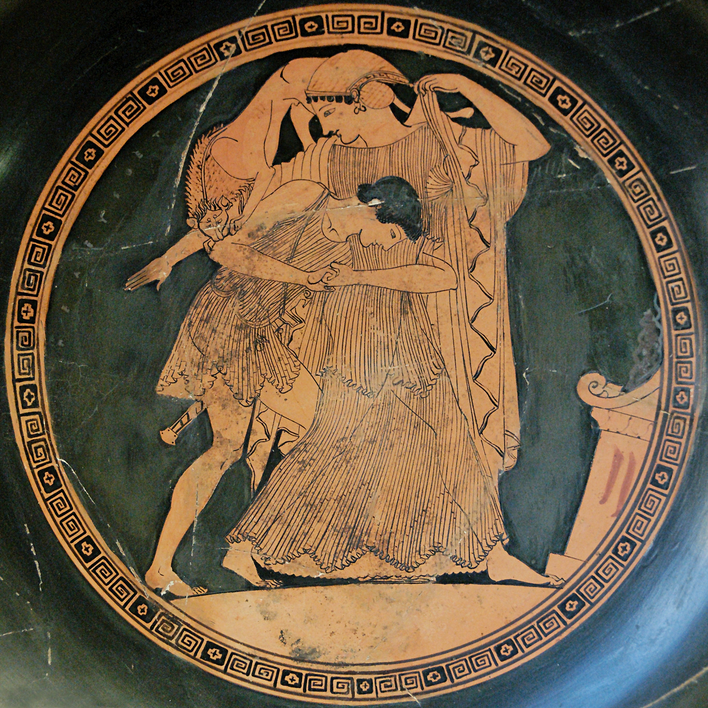 Figure 3: On an early fifth-century BC drinking cup from Attica, the sea nymph Thetis changes her shape into, among other things, a lion (depicted on her right shoulder here) to escape the grasp of her future husband Peleus.   Photo credit: Wikimedia Commons.