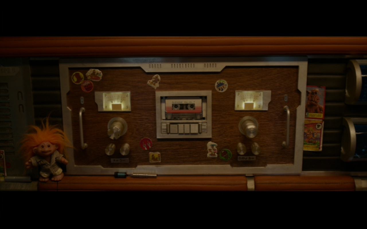 Figure 2: Quill's tape deck on the  Milano . Note the  Alf  and  Garbage Pail Kids  trading cards on the right and the troll doll on the left.