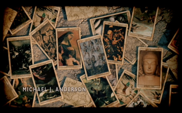 Figure 1: the first shot of the opener of  Carnivàle . I can only make out the subjects of three of the images.