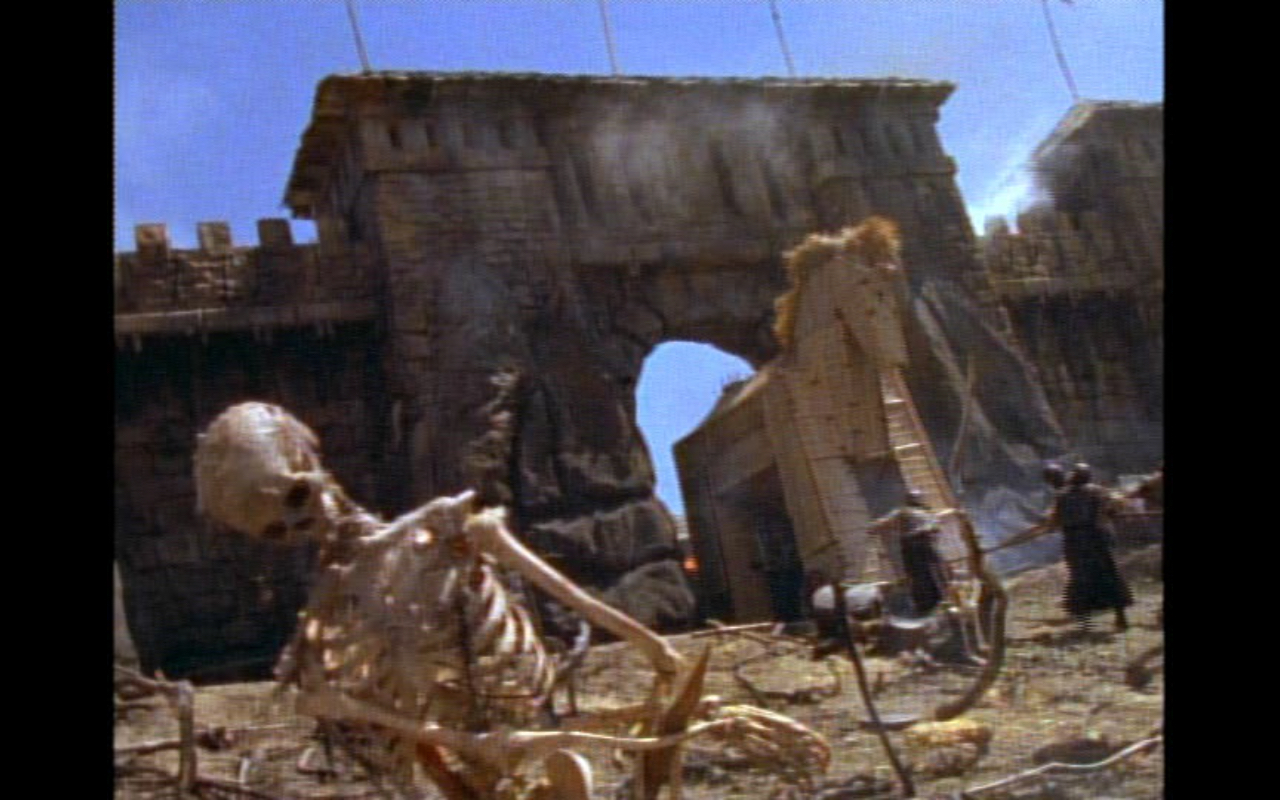 """Figure 4: The grim battlefield of Troy in """"Beware Greeks Bearing Gifts."""" I can't help but see some influence from producer Sam Raimi, who also directed the  Evil Dead  series of films."""