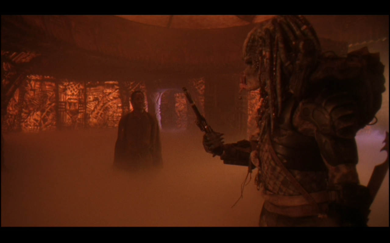 Figure 3: After Detective Harrigan kills one of the aliens with its own weapon, a Predator Elder lets him go, giving him a parting gift: a flintlock pistol stamped 1715 in recognition of his kill. (I wonder how much he would've gotten for this if he had just brought it to  Pawn Stars !)  Predator 2  was not as good as its predecessor, but at least it brought Glover  Predator Dancing  into the world.