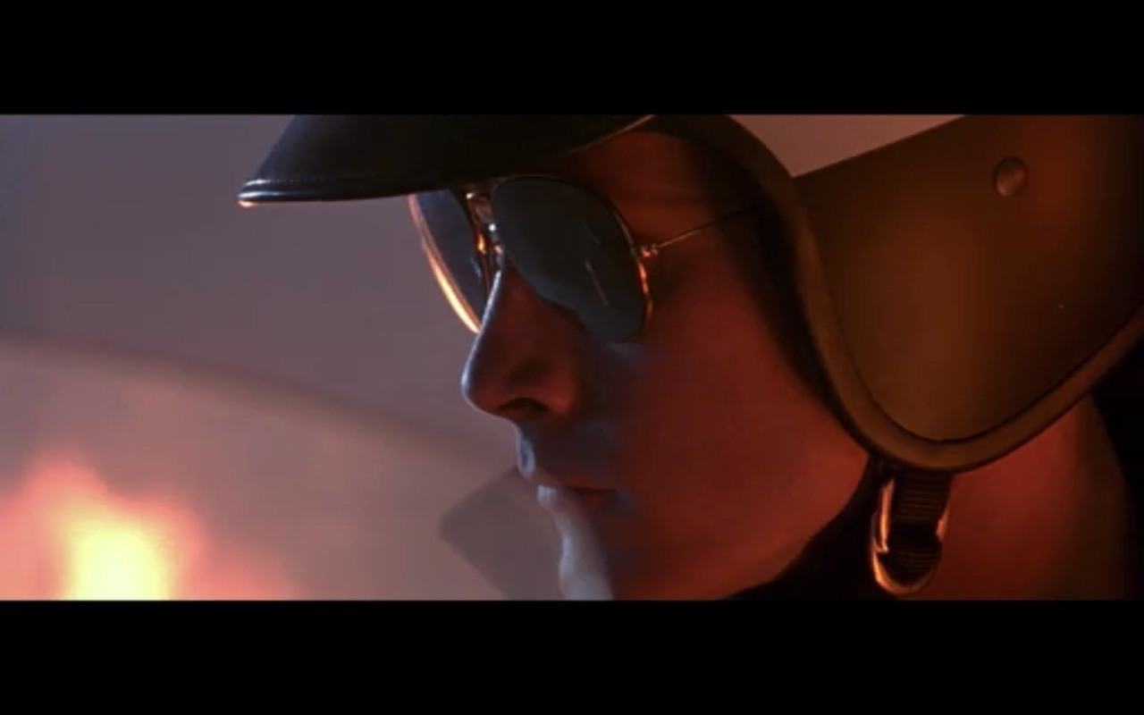 Figure 2: Robert Patrick as the T-1000 in  T2 . In the first part of the film he kills a cop and copies his clothing with his liquid-metal body. He appears with the mirror aviator glasses and motorcycle helmet only after the Connors have destroyed Cyberdyne, so he has presumably killed another cop in the meantime.