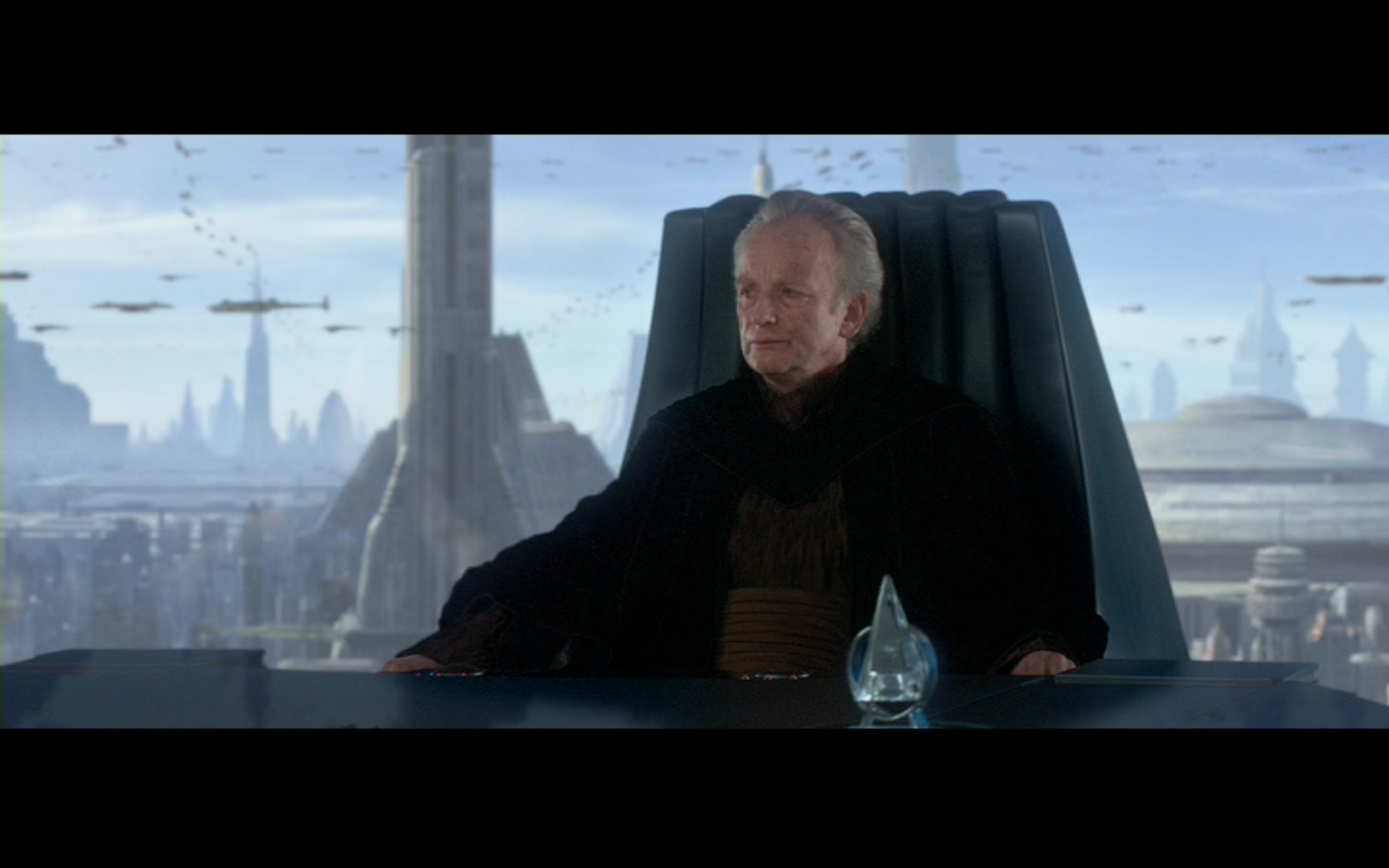 Figure 2: When we first meet him in  The Phantom Menace , Sheev Palpatine appears to be a humble senator, but he quickly rises through the senate's ranks and becomes the galaxy's first emperor. Photo credits: Twentieth Century Fox (DVD).