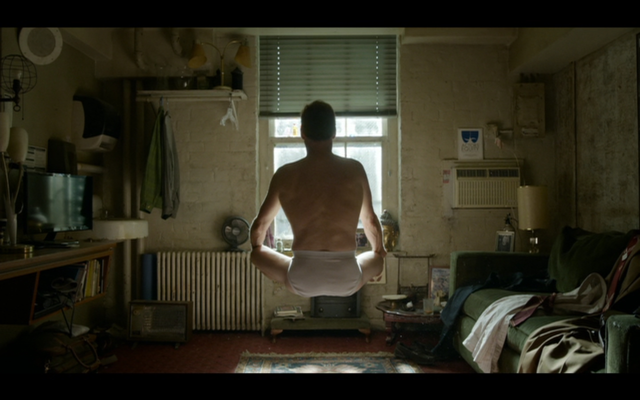 "Figure 2: Riggan floats in the air in his dressing room in  Birdman, or (The Unexpected Virtue of Ignorance)  (Iñárritu 2014). This ""superpower"" is undercut by the fact that Riggan is hovering serenely in his tighty-whiteys. Credit: screen capture (New Regency Pictures/M Productions/Le Gribsi)"