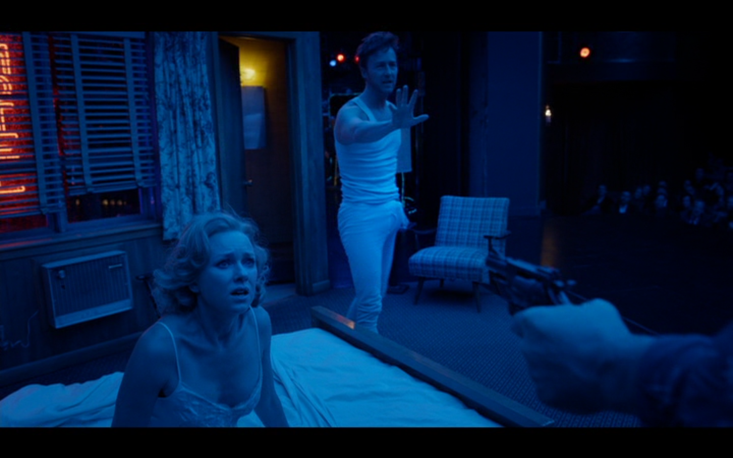 "Figure 4: Mike Shiner has a visible erection on stage during the Raymond Carver adaptation in  Birdman, or (The Unexpected Virtue of Ignorance ) (Iñárritu 2014). His ex grumbles, ""You can't get it up in six months and now you want to fuck me in front of 800 strangers?!"" as they take their bows in front of an applauding and cheering audience. Mike, the pretentious Broadway actor to the last, explains himself: ""I need it to feel real, okay? I need that intensity. I was in the moment."" Credit: screen capture (New Regency Pictures/M Productions/Le Gribsi)."