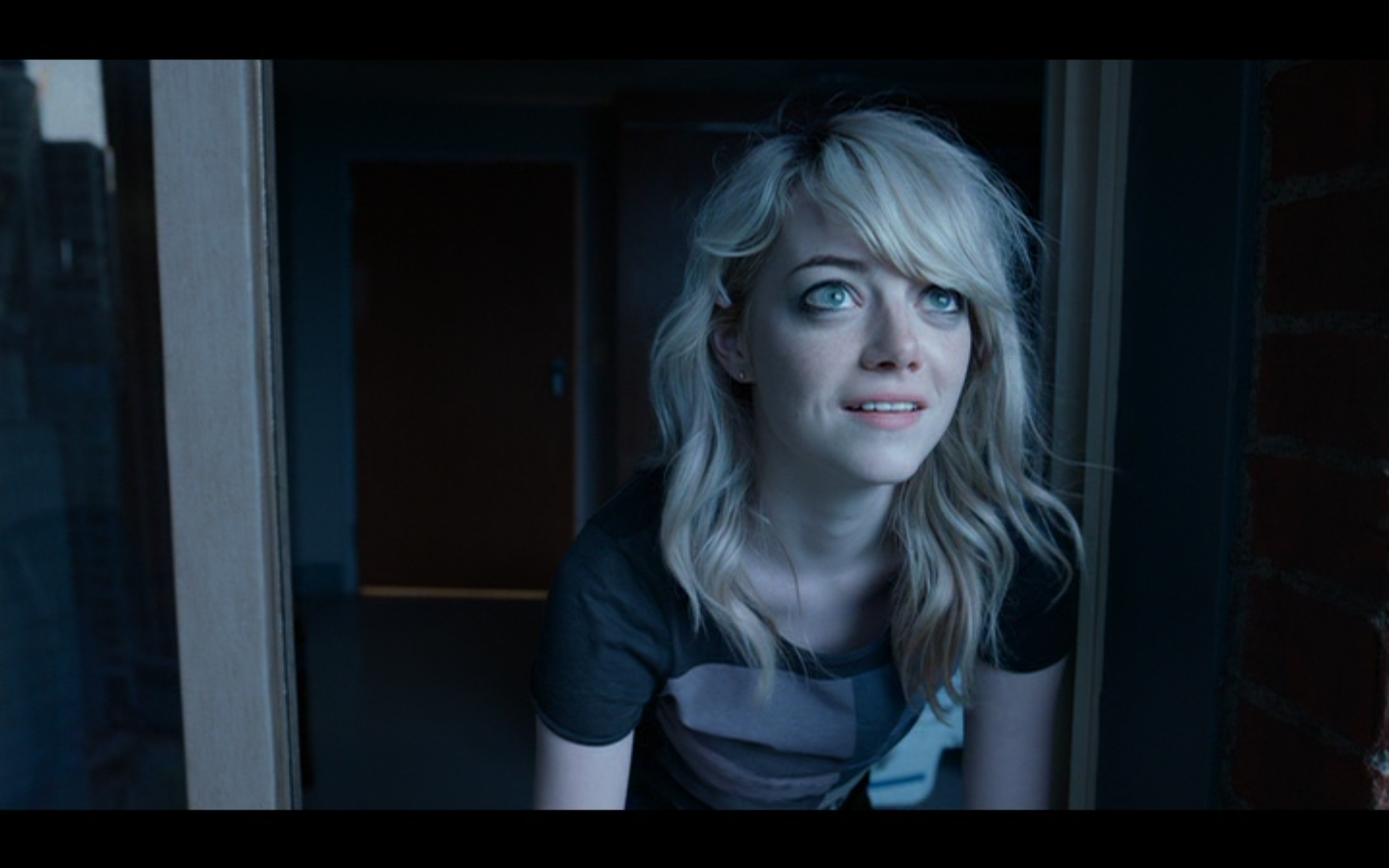 "Figure 5: In the final shot of  Birdman, or (The Unexpected Virtue of Ignorance)  (Iñárritu 2014), Emma Stone's character looks out of the hospital window that her father leapt out of. The meaning of her expression has been much debated, but given her smile as she looks upward, I interpret it to mean that Riggan is soaring through the New York skies as Birdman once again, having transcended his small-minded attitude about ""art."" Credit: screen capture (New Regency Pictures/M Productions/Le Gribsi)."