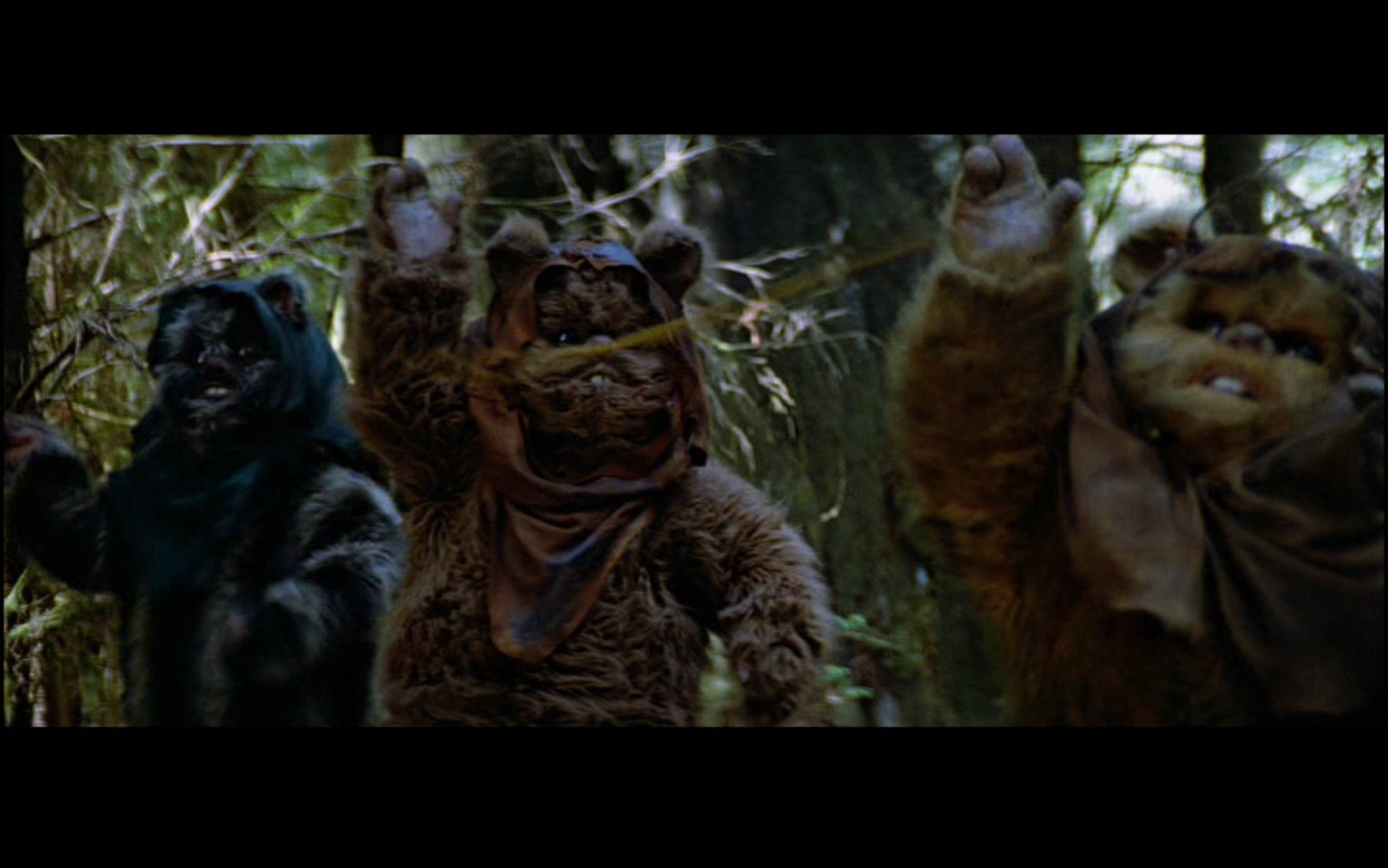Figure 2: Ewoks swing rocks attached to ropes, in most cases knocking out stormtroopers, although poor Wicket ends up taking himself out! Image credit: screen capture from  Return of the Jedi  (20th century Fox/Lucasfilm).