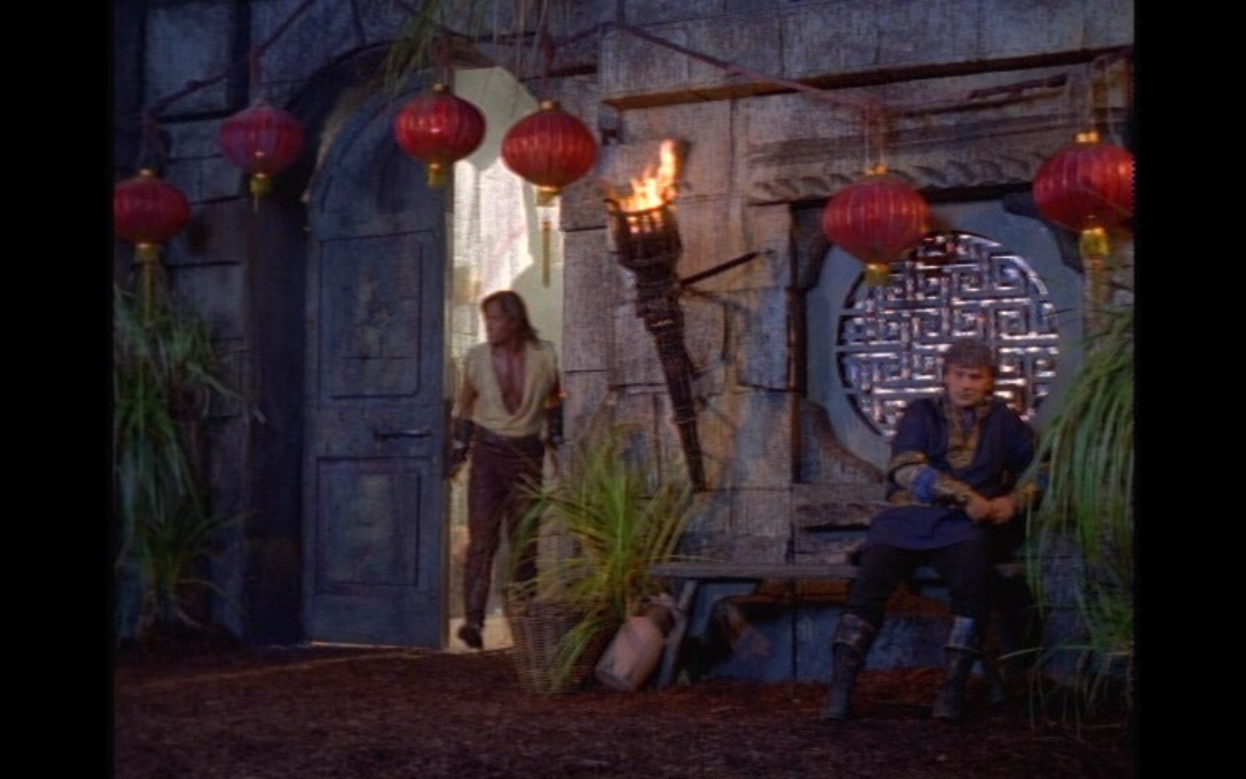 """Figure 3: In the  Hercules: the Legendary Journeys  episode """"Once a Hero,"""" Jason's palace at Corinth is decorated with strings of red Chinese paper lanterns and has a window decorated with Chinese ornamental designs."""