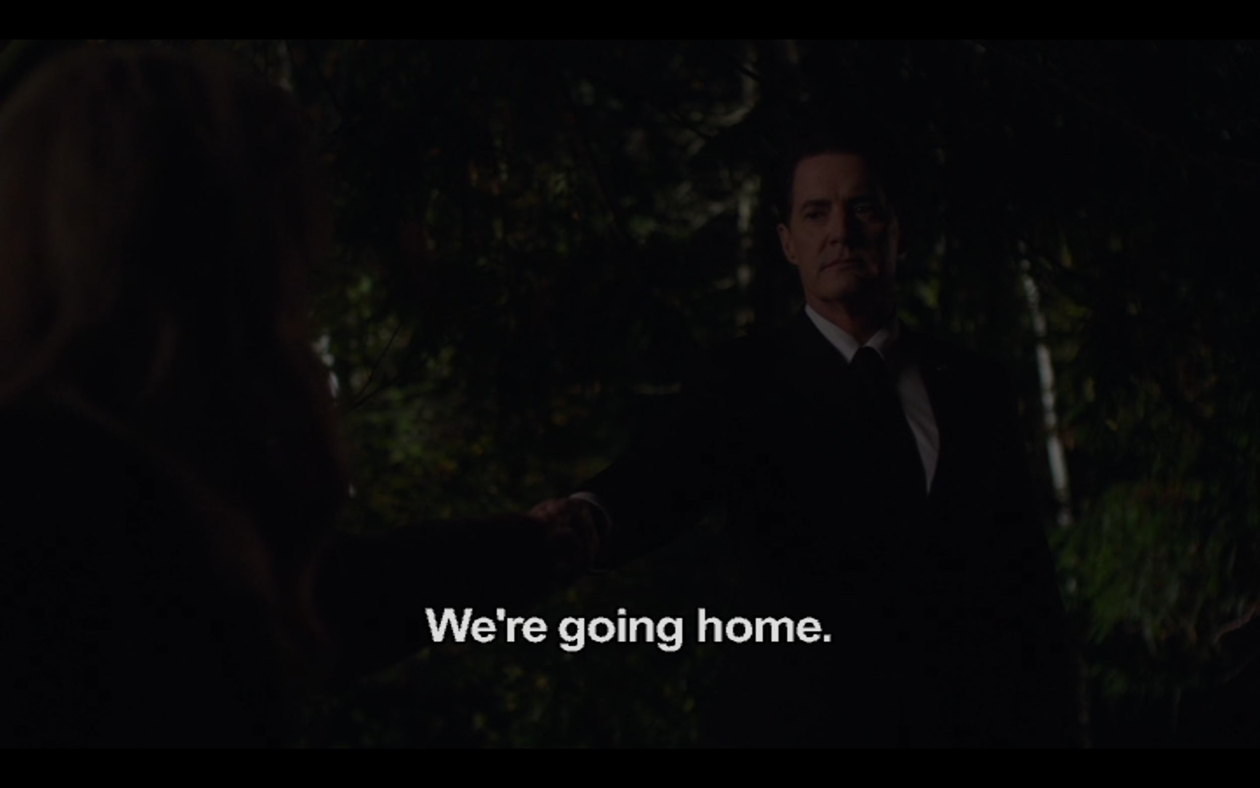 """Figure 4: 2017 Cooper tries to prevent 1989 Laura Palmer from being murdered in  Twin Peaks  season 3 episode 17. The camera angle in this shot and Cooper's body language are reminiscent of the Terminator's behavior towards Sara Conner in  Terminator 2: Judgement Day  (""""Come with me if you want to live."""")"""