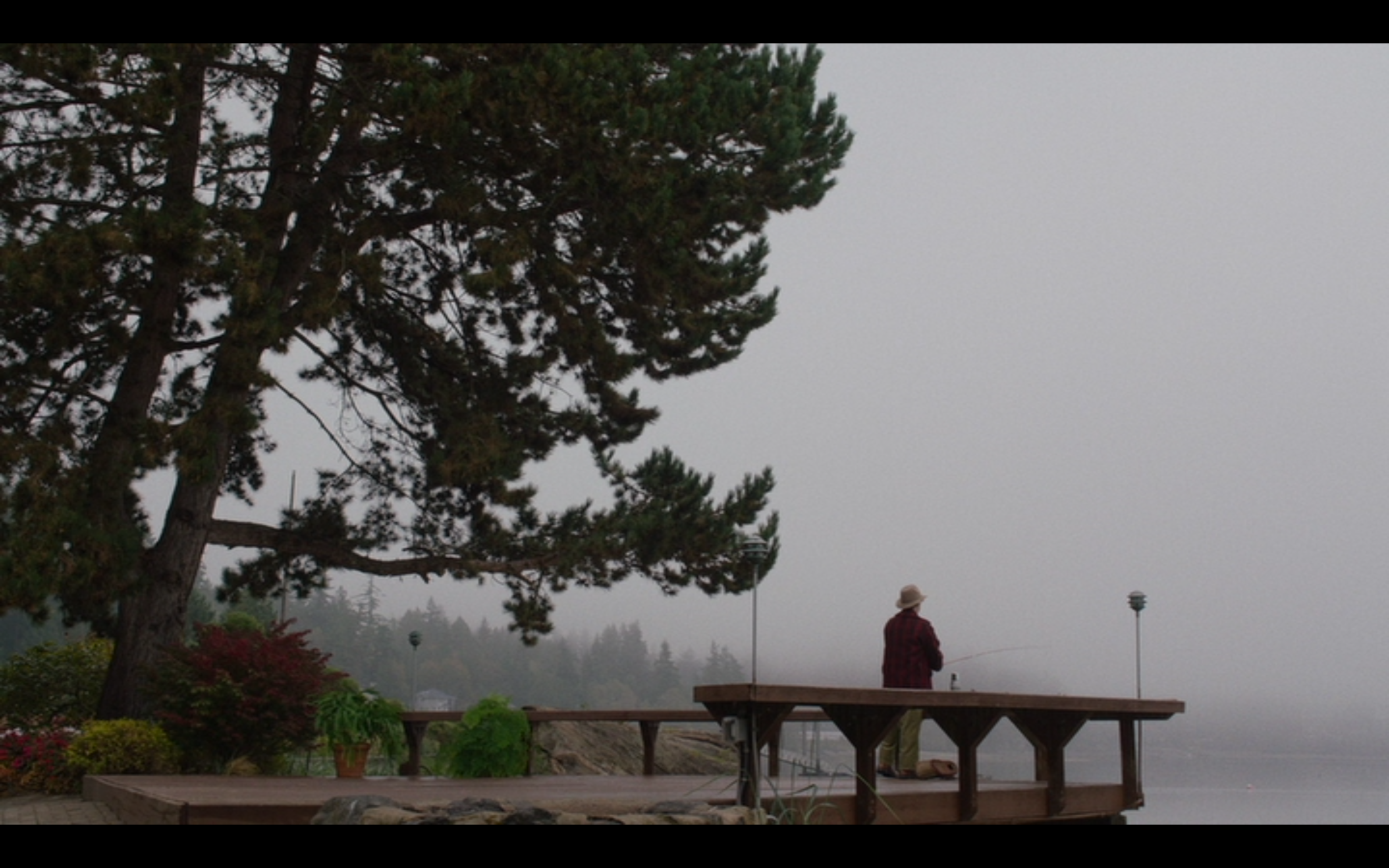 Figure 5: Pete Martell fishes from a pier in Twin Peaks and does not discover Laura Palmer's body in  Twin Peaks  season 3 episode 17, whereas he did in  Twin Peaks  season 1 episode 1.