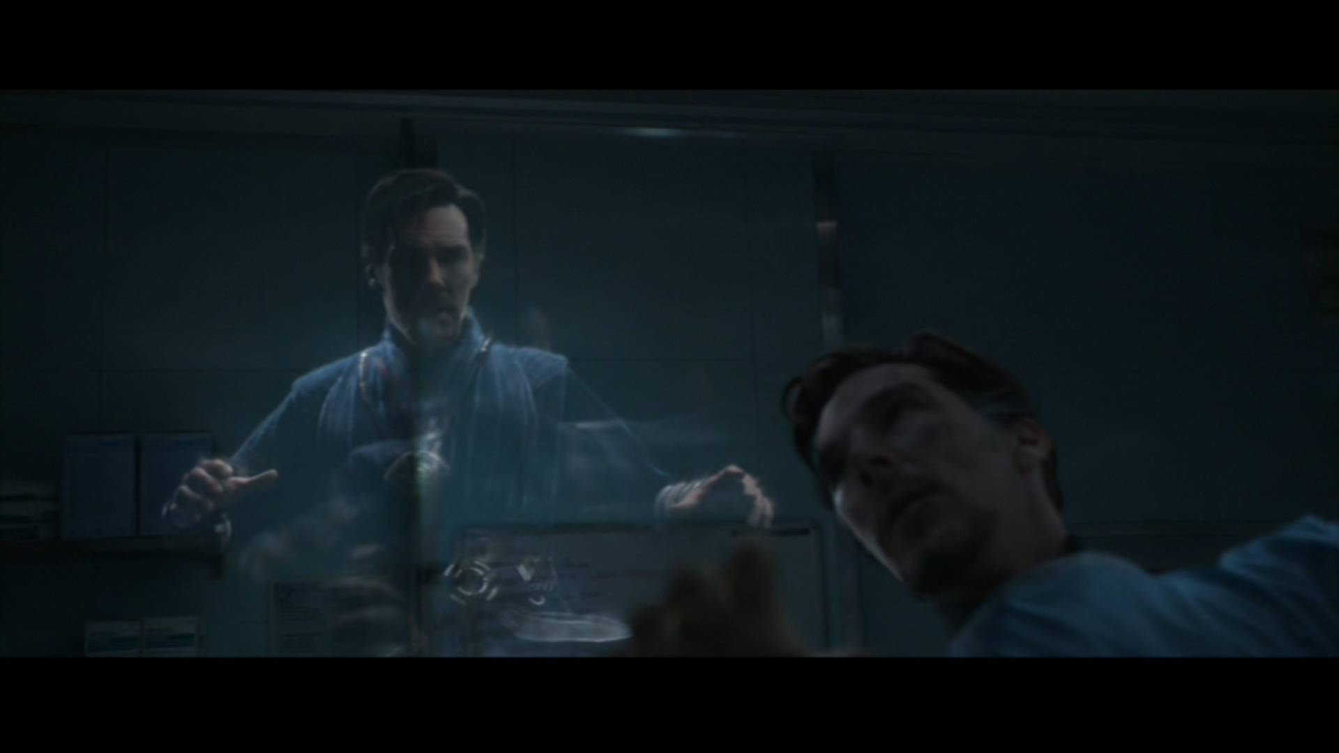 Figure 5: When Strange and Palmer operate on the Ancient One, Strange is dressed in medical scrubs in his physical form, whereas his astral form is wearing the outfit that he donned during his mystical training in Kamar-Taj.  Doctor Strange  (Derrickson 2016), Marvel Studios/Walt Disney Studios Motion Pictures.