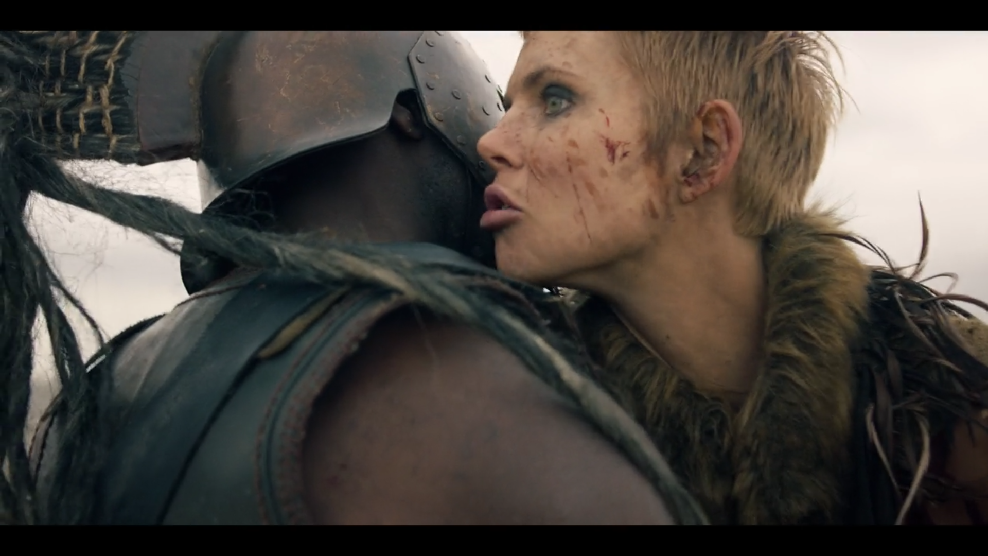 """Figure 4: A blood-spattered Penthesilea whispers to Achilles after he's delivered the killing blow to her in the TROY: FALL OF A CITY episode """"Twelve Days"""" (1.7; 2019). Credit: BBC/Netflix."""