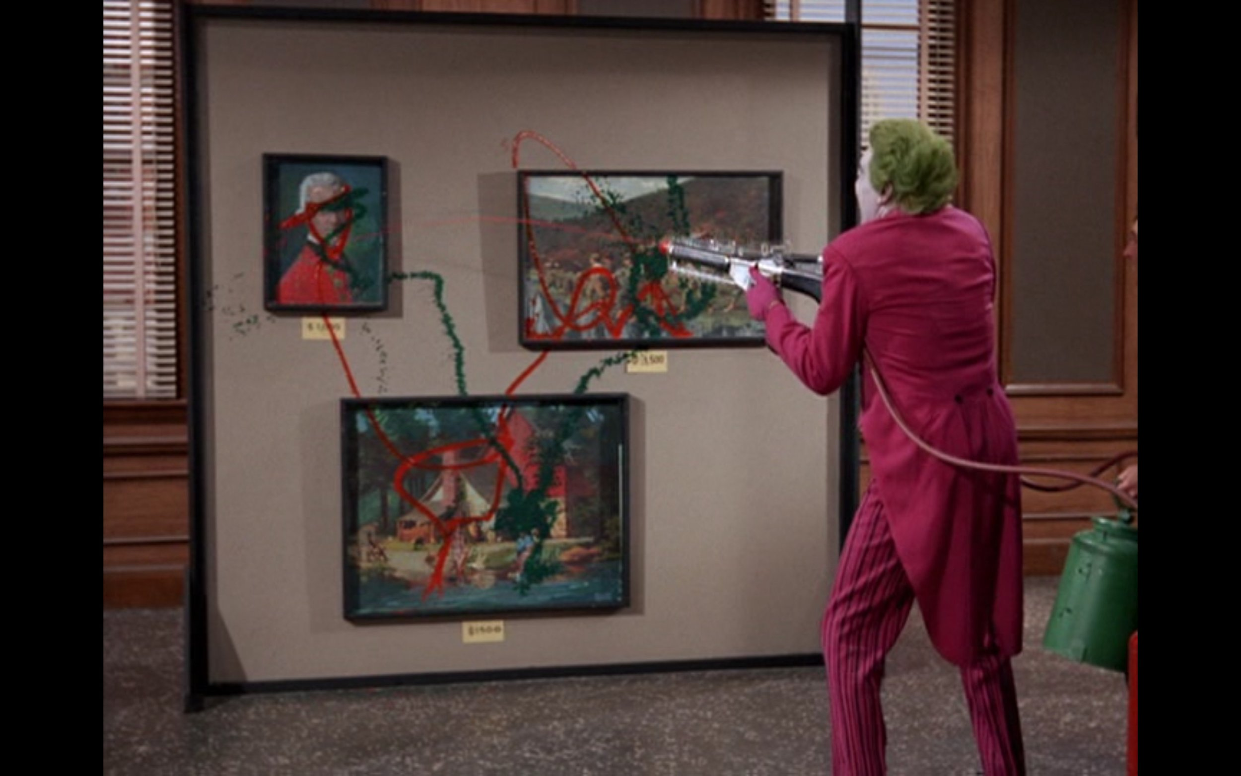 "Figure 1: The Joker sprays red and green paint on works that represent iconic American art in the BATMAN television series episode ""Pop Goes the Joker."" Credit: 20th Century Fox Television/Greenway Productions/ABC Studios."