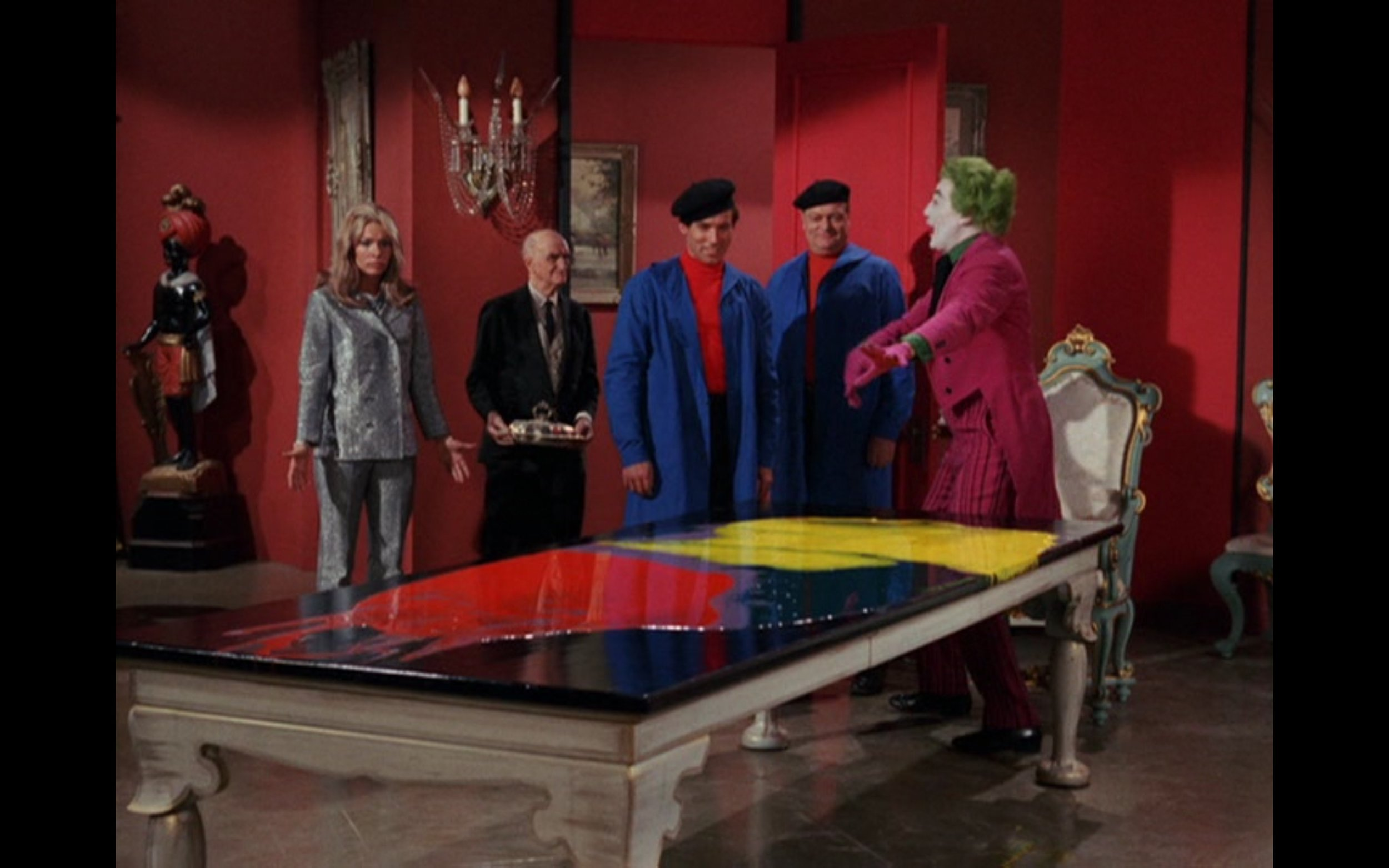 "Figure 3: Joker creates art to replace the paintings in the Gotham City Museum, which, in his words, are ""A lot of dusty relics of the past. Outworn and outmoded."" From the episode ""Flop Goes the Joker"" (2.58, 1967); credit: 20th Century Fox Television/Greenway Productions/ABC Studios"