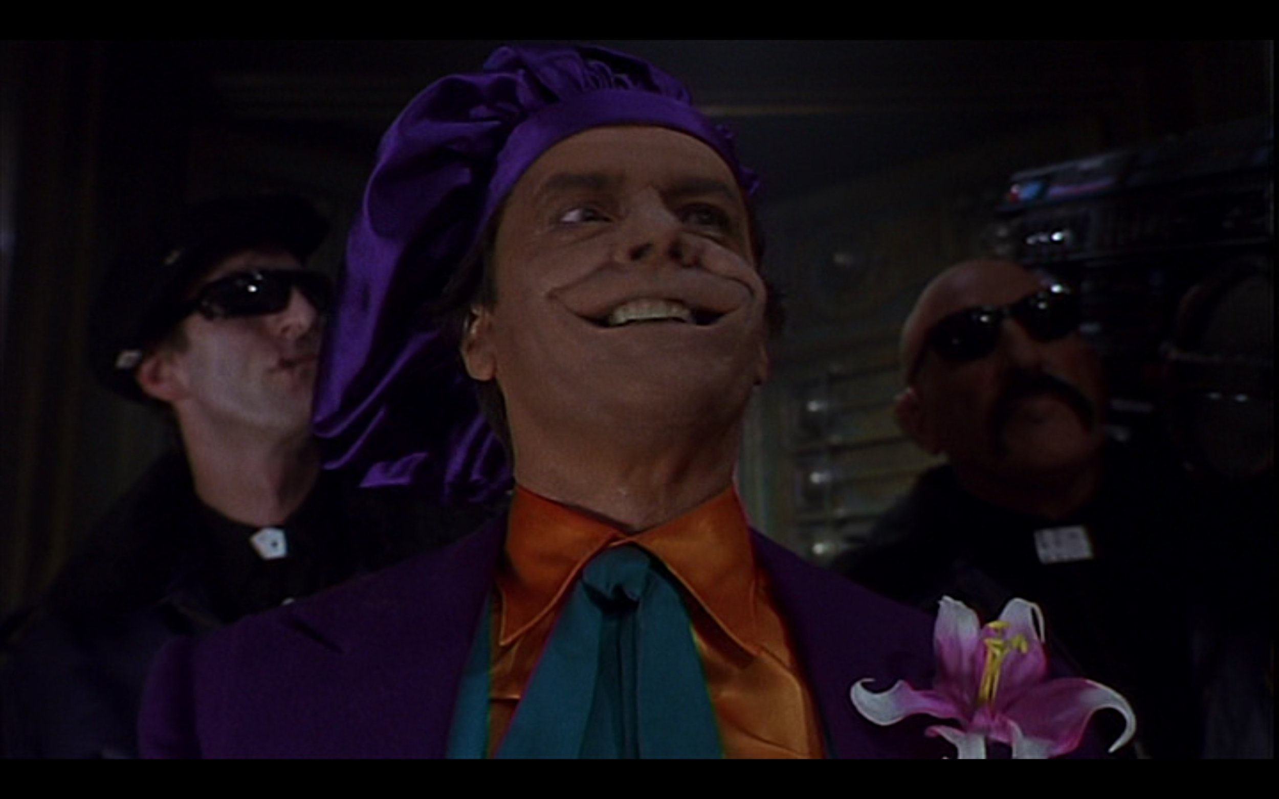 Figure 4: Joker's purple beret reminds us of one of the most iconic parts of a stereotypical artist's outfit in the film BATMAN (Burton 1989). Credit: Warner Brothers, The Gruber-Peters Company, Polygram Pictures.