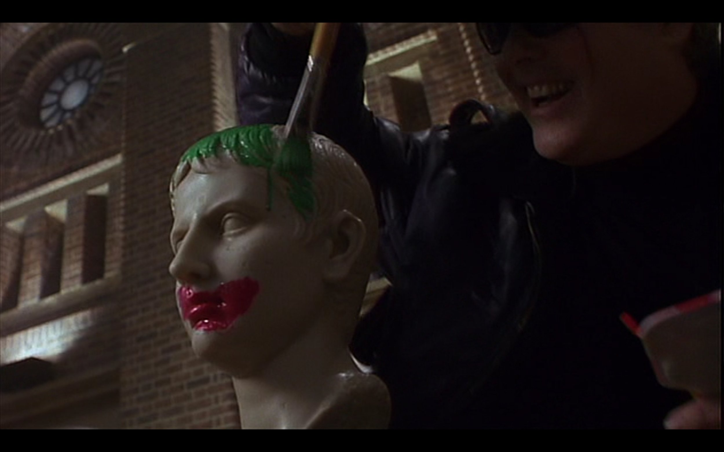 Figure 6: A bust of the young Octavian (who will eventually become the Roman emperor Augustus), is given green hair and red lips like the Joker in the film BATMAN (Burton 1989). Credit: Warner Brothers, The Gruber-Peters Company, Polygram Pictures.