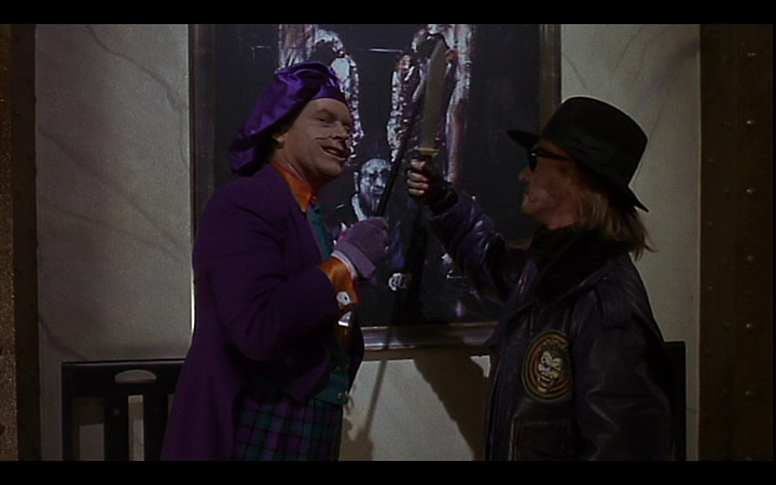 "Figure 7: In the film BATMAN (Burton 1989), Bob prepares to slash the Francis Bacon painting ""Figure with Meat"" to shreds, but Joker stops him: ""I like this one, Bob. Leave it."" Credit: Warner Brothers, The Gruber-Peters Company, Polygram Pictures."