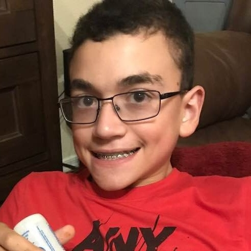 This young man's dentist and orthodontist work together to ensure he can enjoy beautiful, healthy teeth.