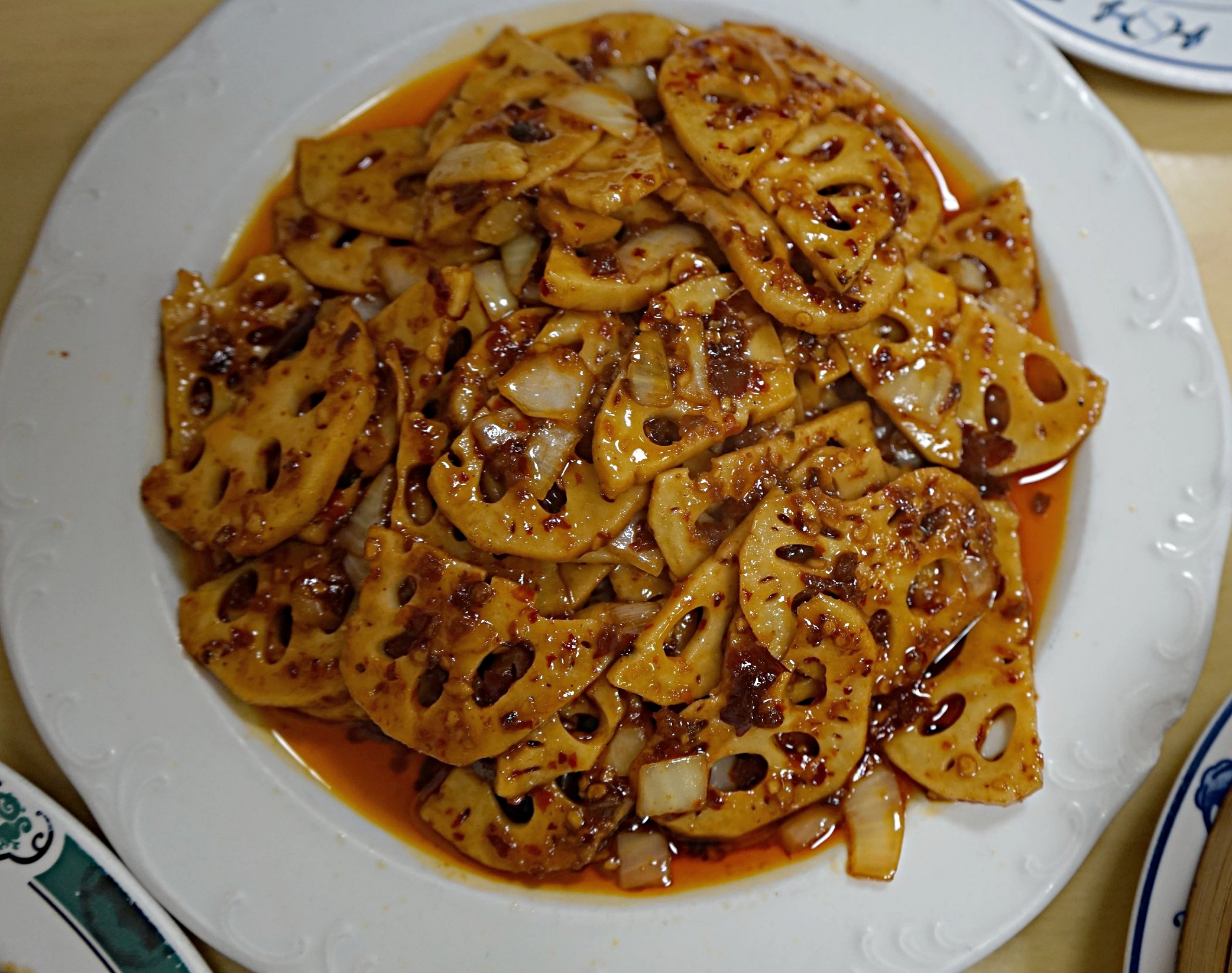I'm not a huge fan of lotus root, but marinated in chili sauce, and tossed with Sautéed onions will make anyone a fan.