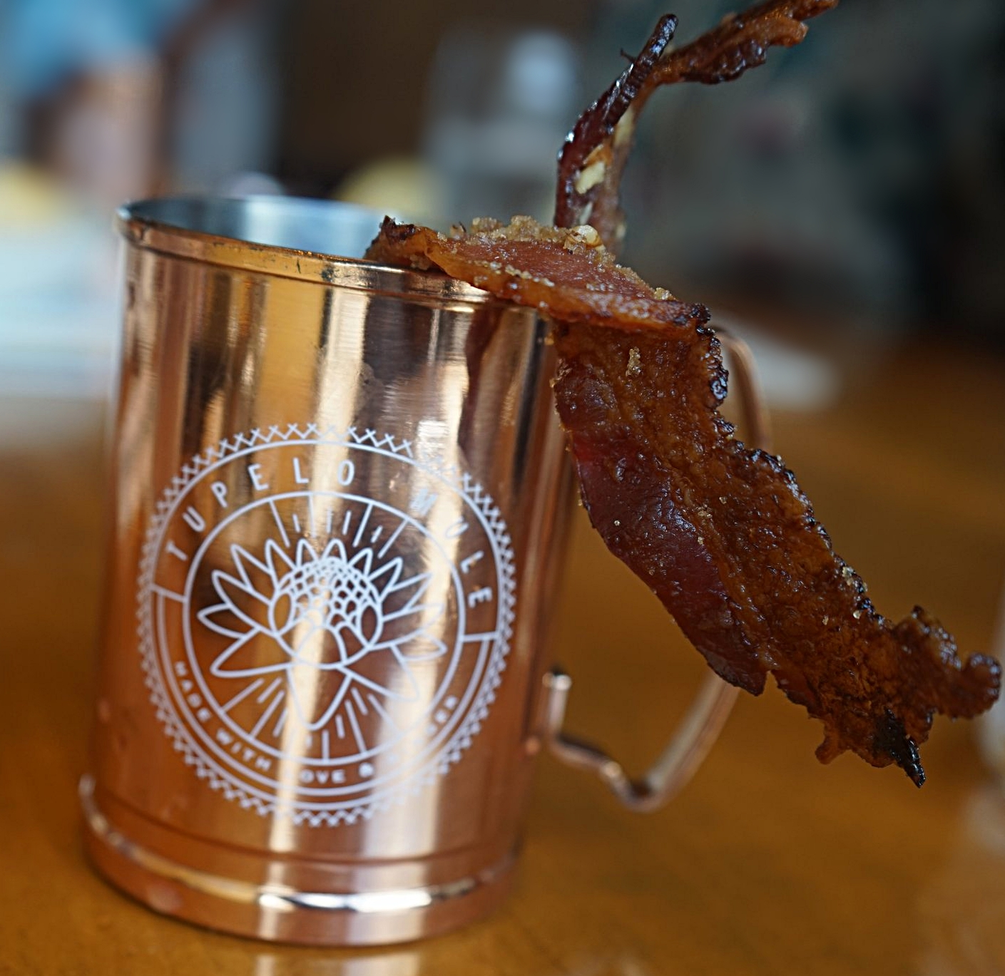 A place that gives a side of bacon its proper respect by putting it in a gold cup.