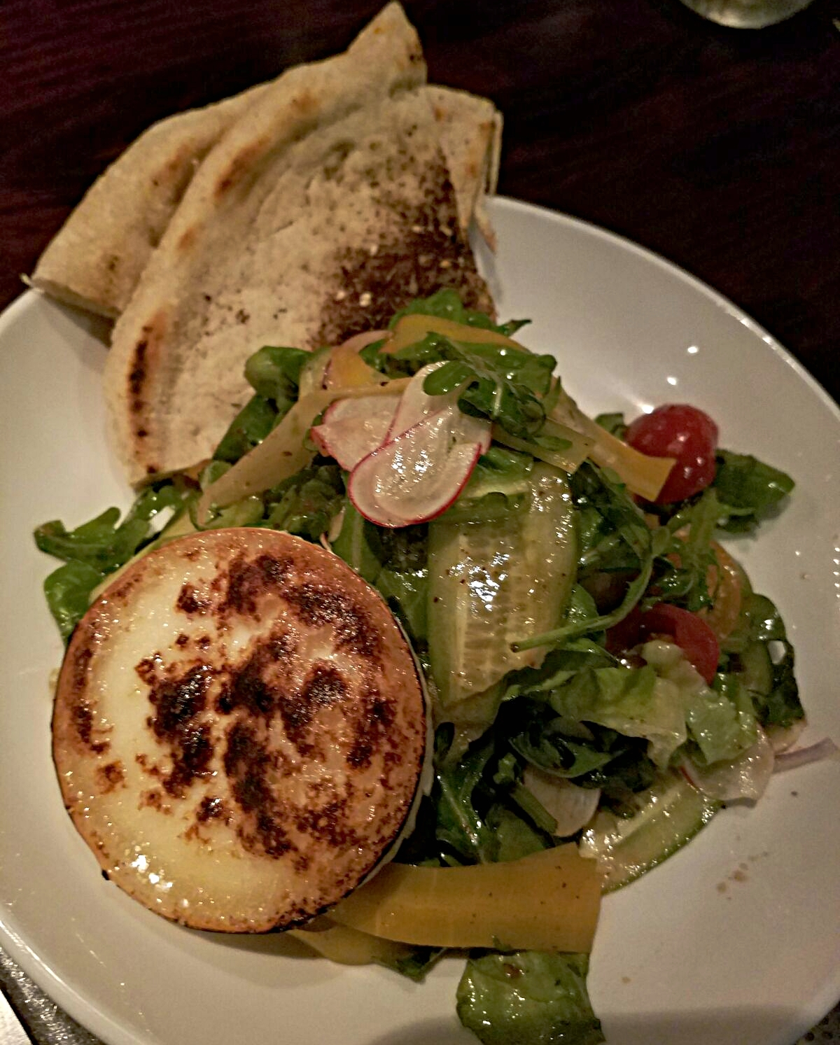GYPSY SALAD. house veggies. goat cheese. warm pita. lemon-sumac dressing. :  UNDER THE CORK TREE.