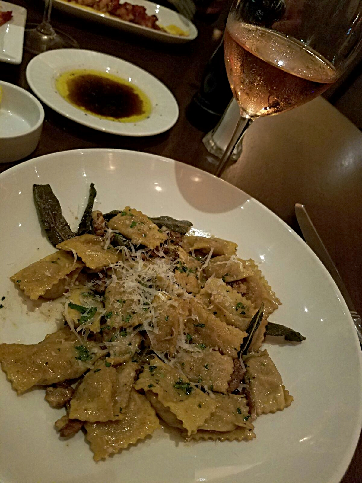 "AGNOLOTTI. ""big green egg"" roasted duck. fontina. brown butter. sage. pecans. :  IL GIALLO ."