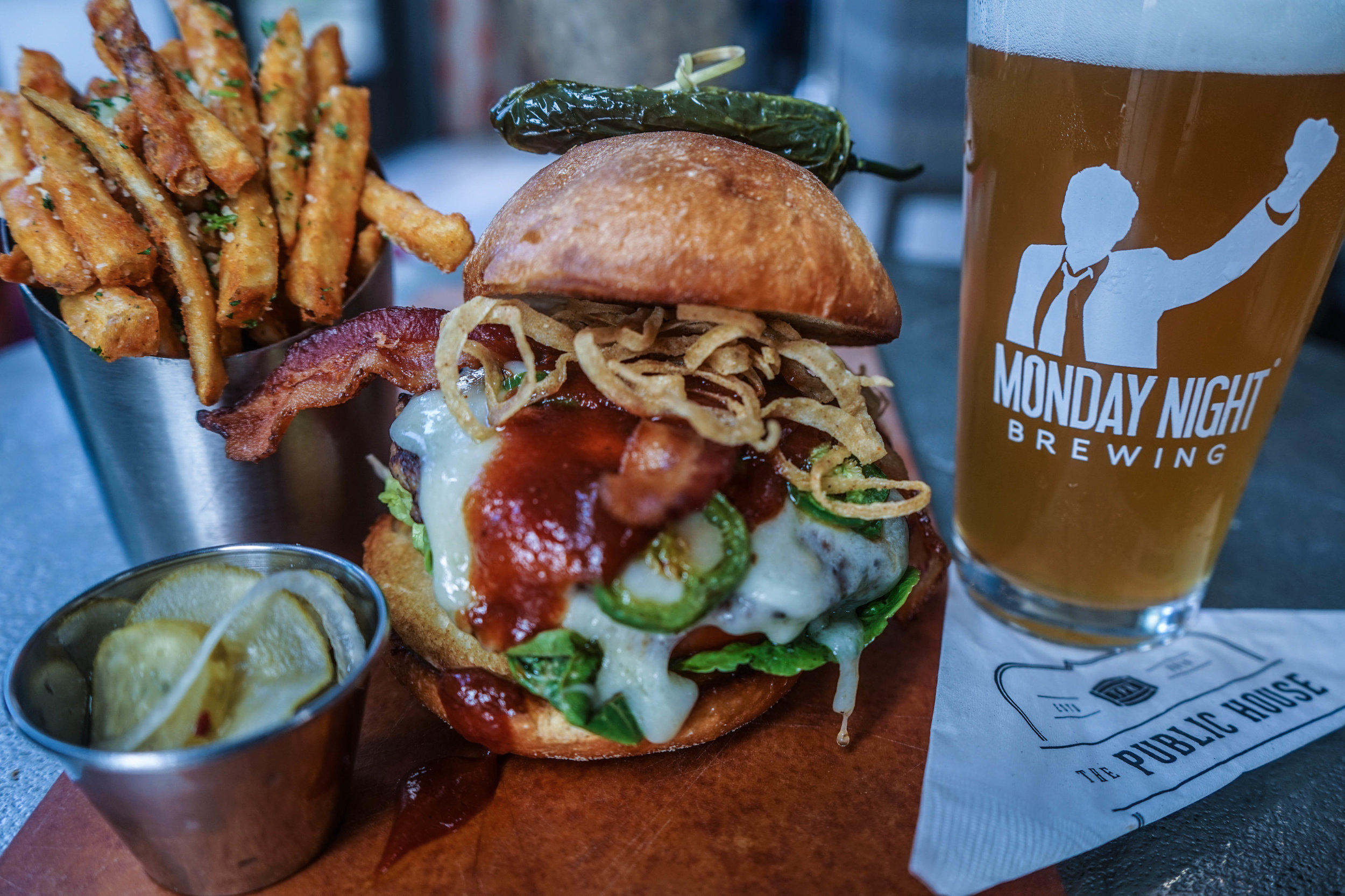 WTH (What The Hamburger), changes weekly.   grilled certified angus beef burger. crispy onion straws. jalapenos. applewood smoked bacon. bbq sauce. toasted brioche bun.