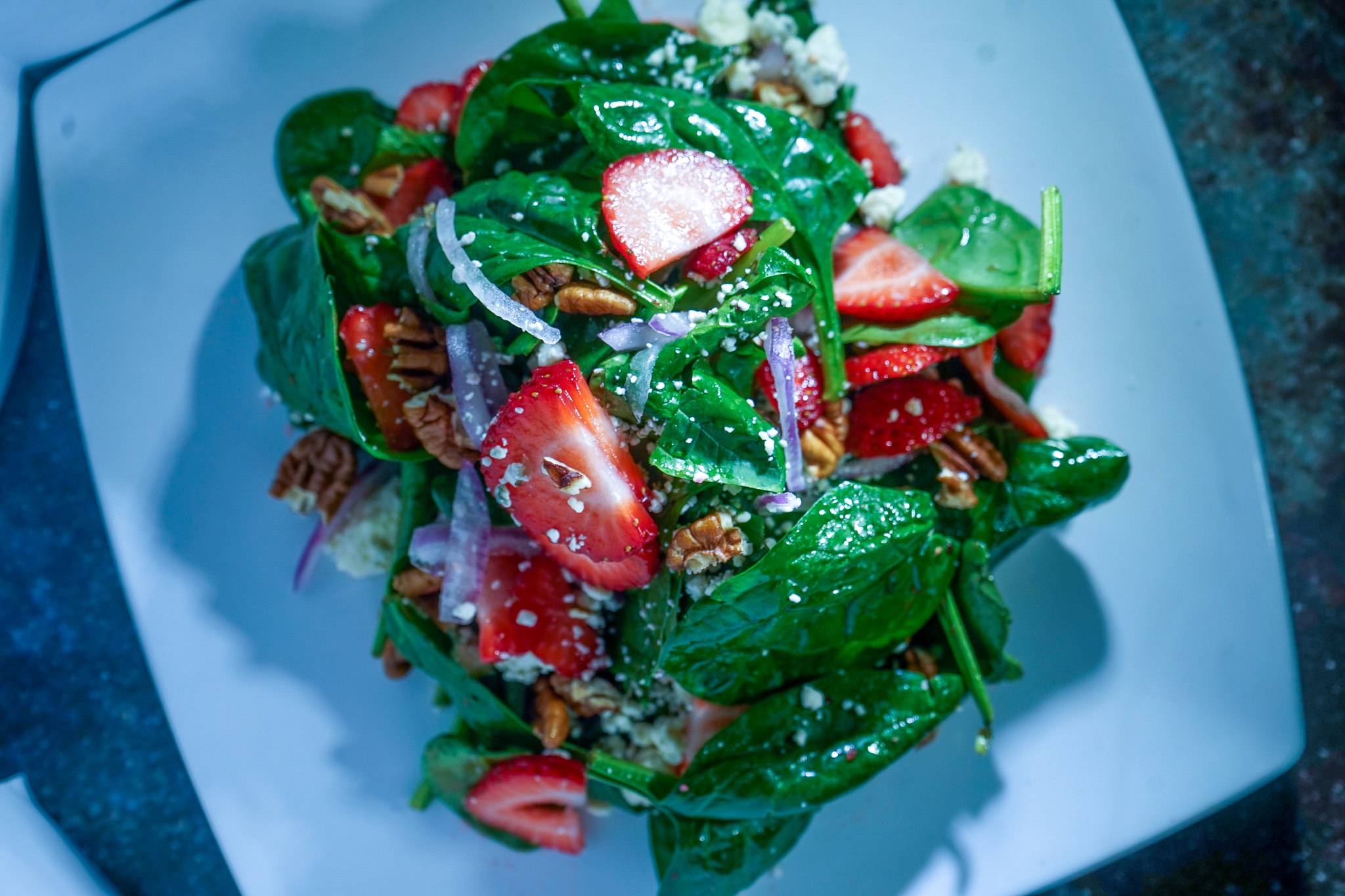 Spinach Strawberry Salad. candied pecans. red onions. strawberries. blue cheese. raspberry vinaigrette.