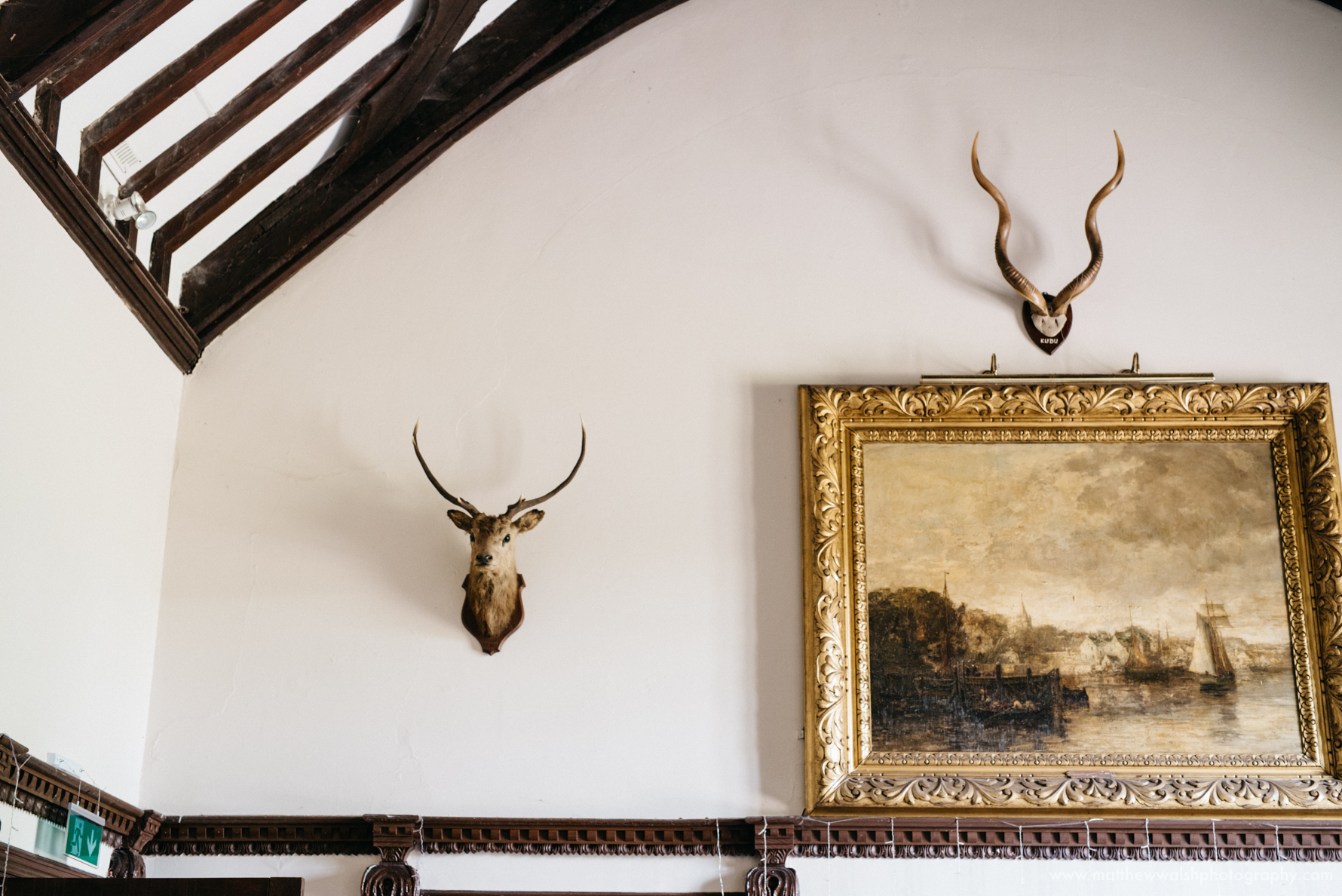The walls of the grand hall adorned with hunting trophies