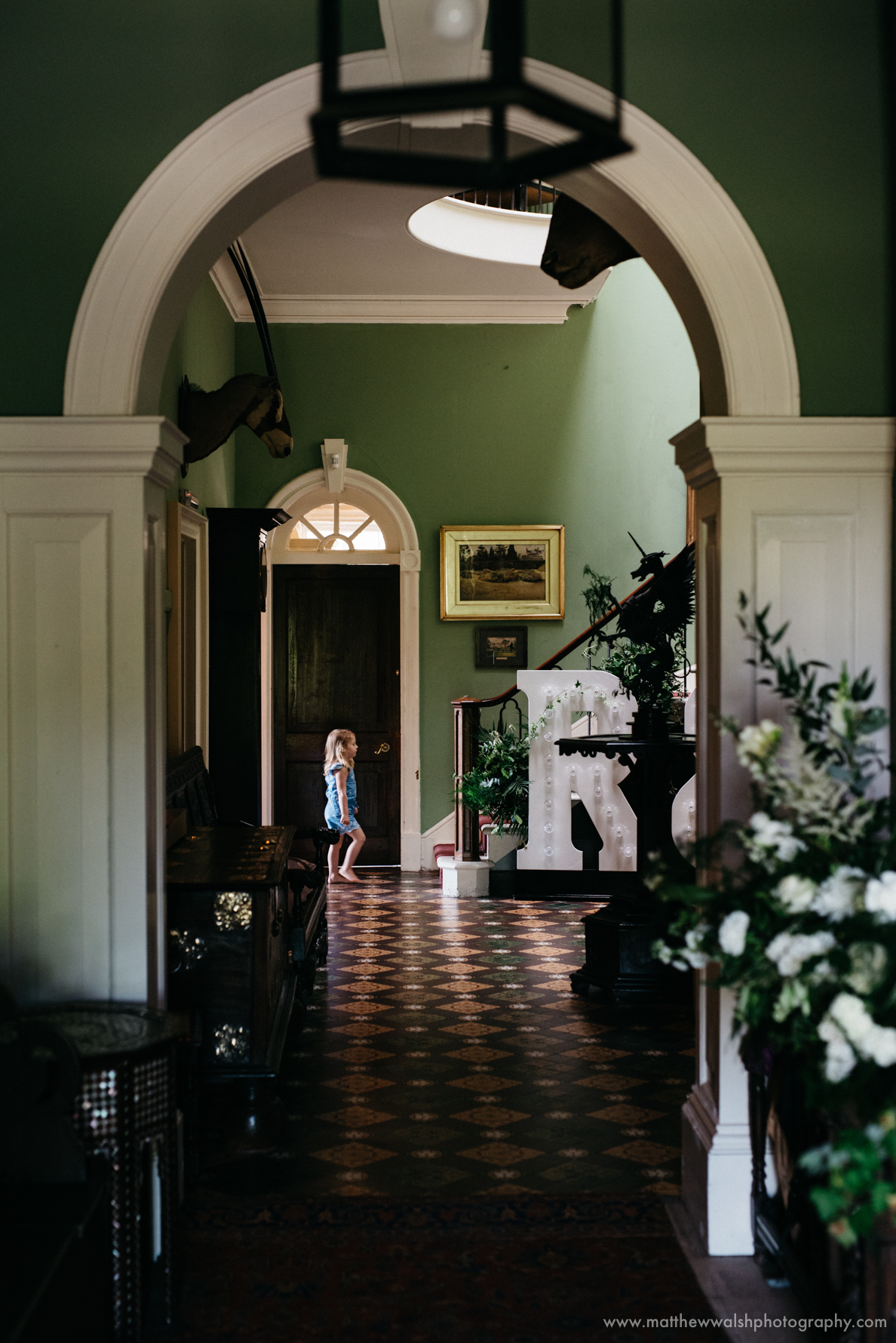 The wonderful colours of the hallway with spaces of natural light from the windows.