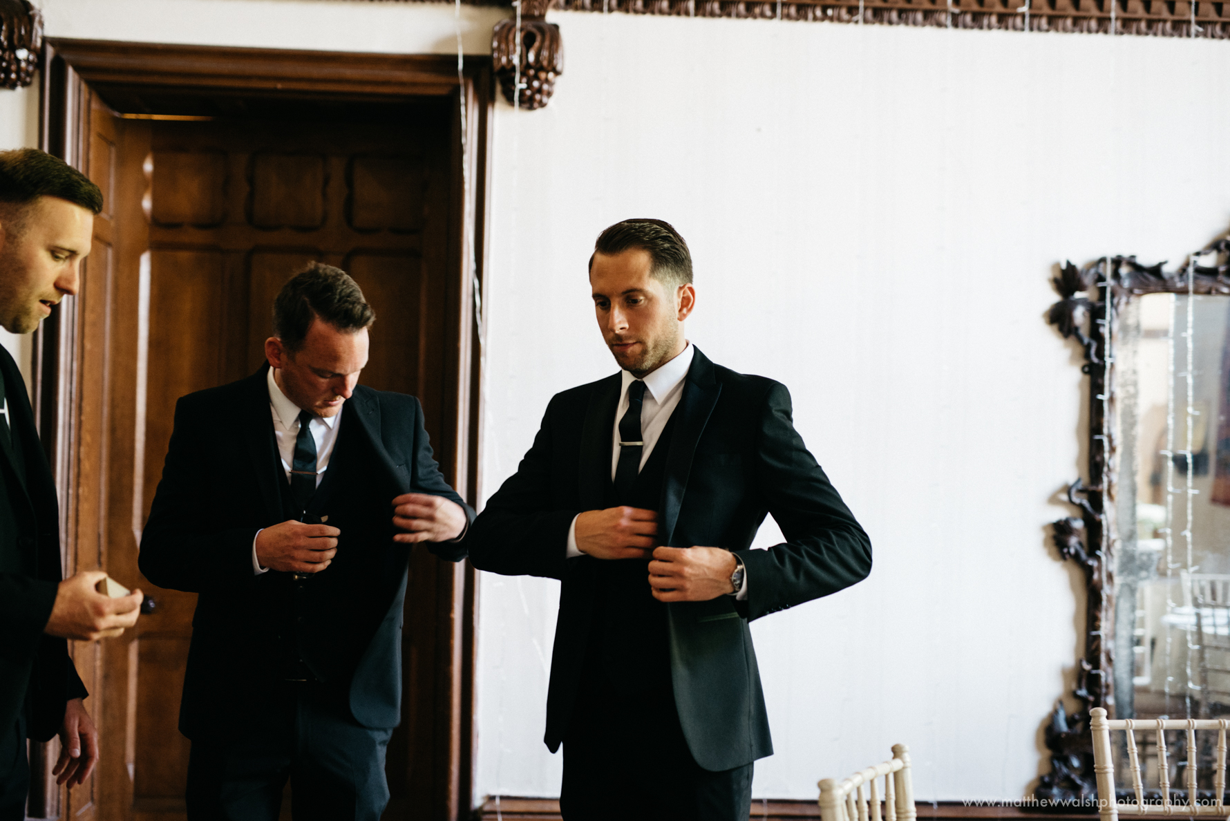 Pre ceremony nerves, the groom and his best men nervously check their pockets