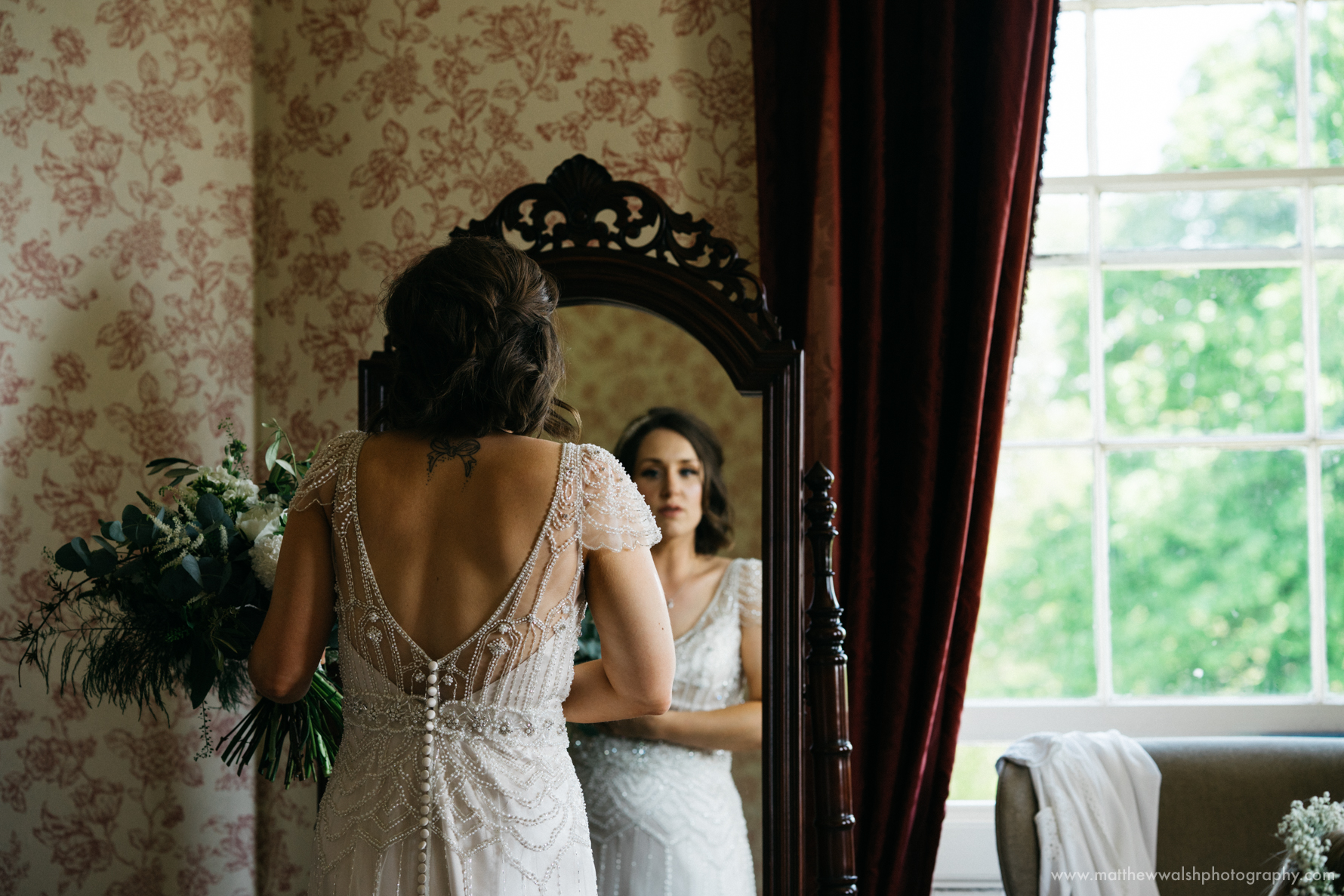 Bride unposed in the mirror